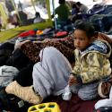 A child traveling with a caravan of migrants from Central America sits at a camp near the San Ysidro checkpoint