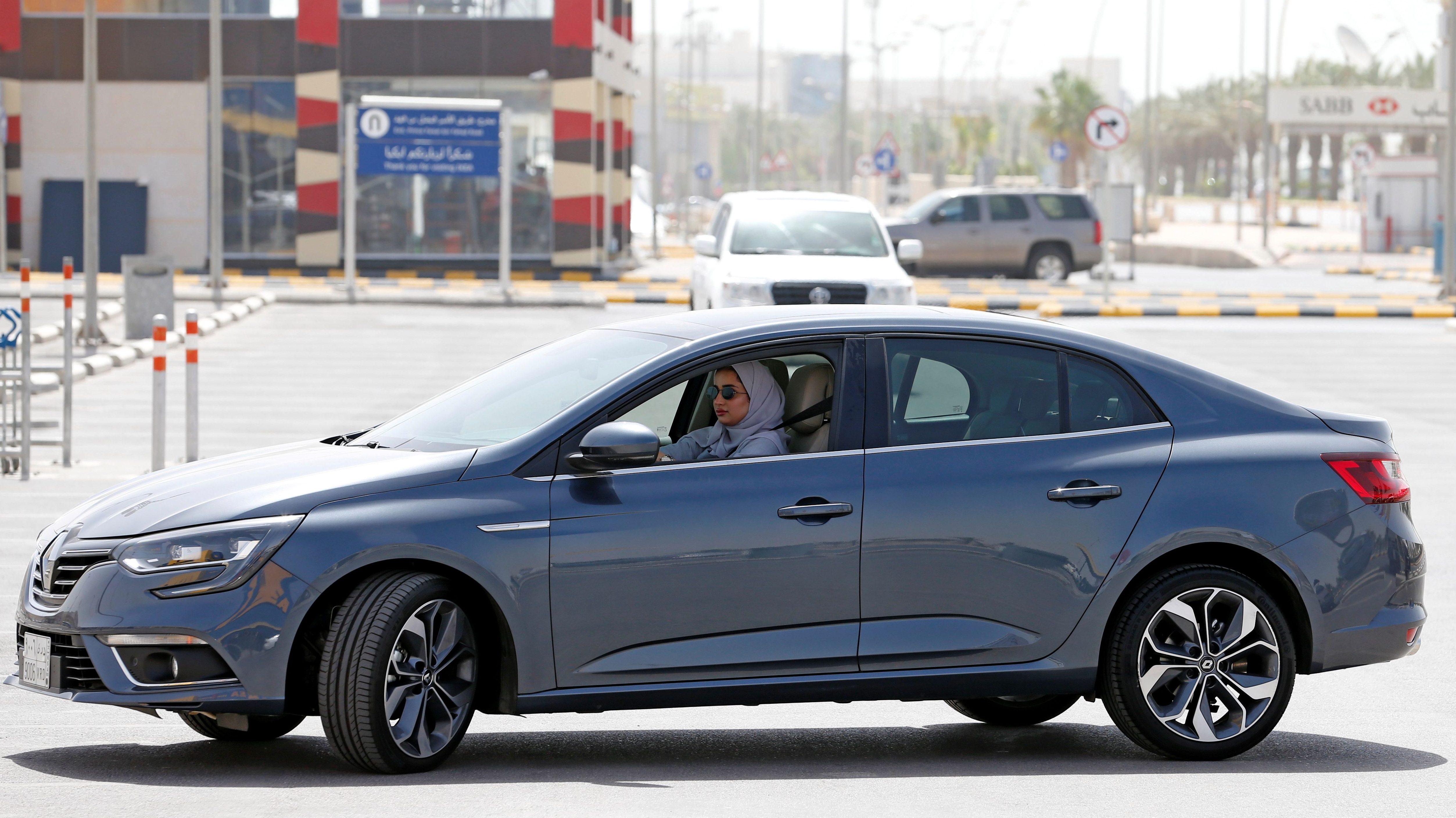Zuhoor Assiri drives her car in Dhahran, Saudi Arabia, June 24, 2018.