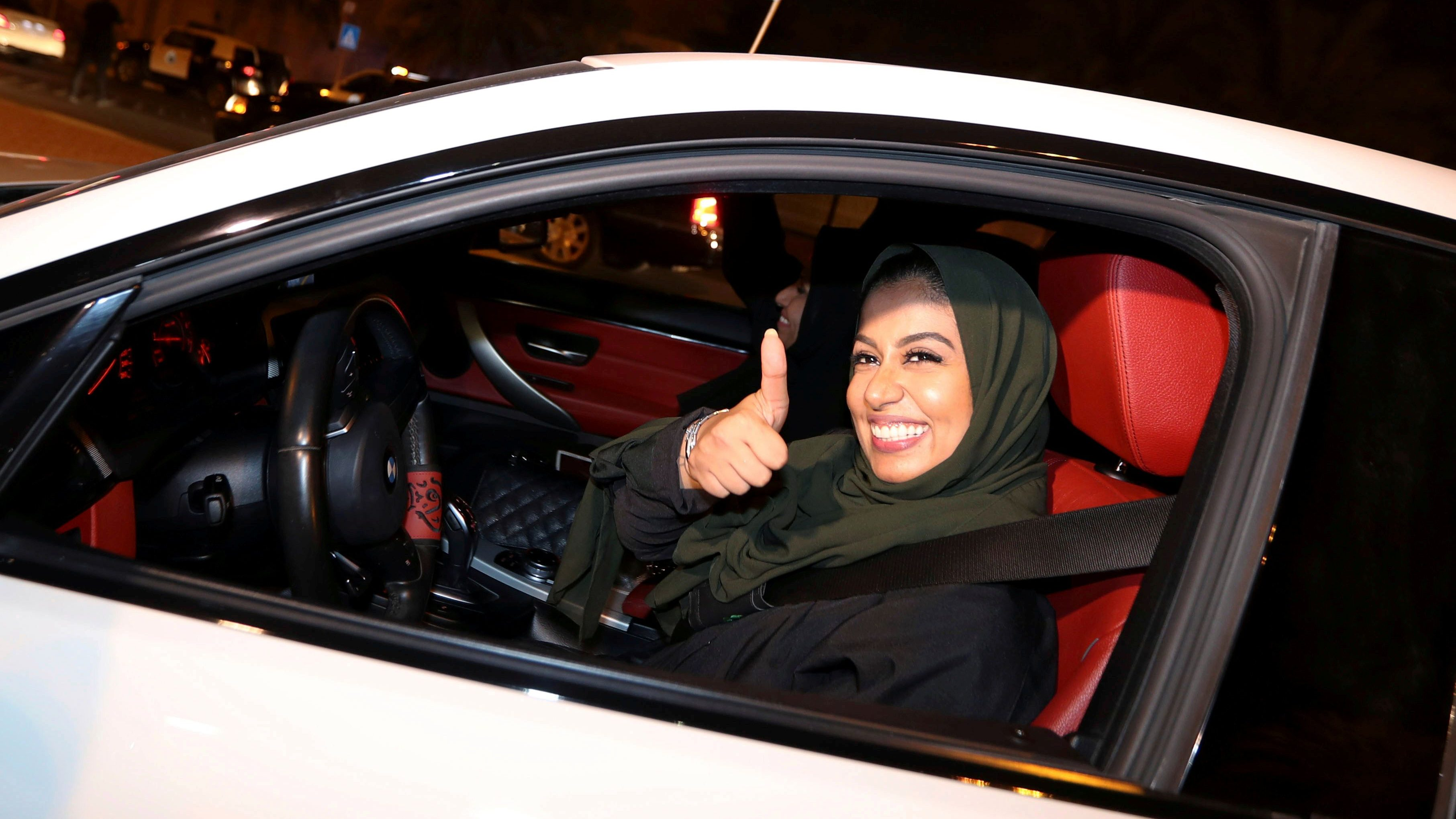 A Saudi woman celebrates as she drives her car in her neighborhood, in Al Khobar,  Saudi Arabia, June 24, 2018.