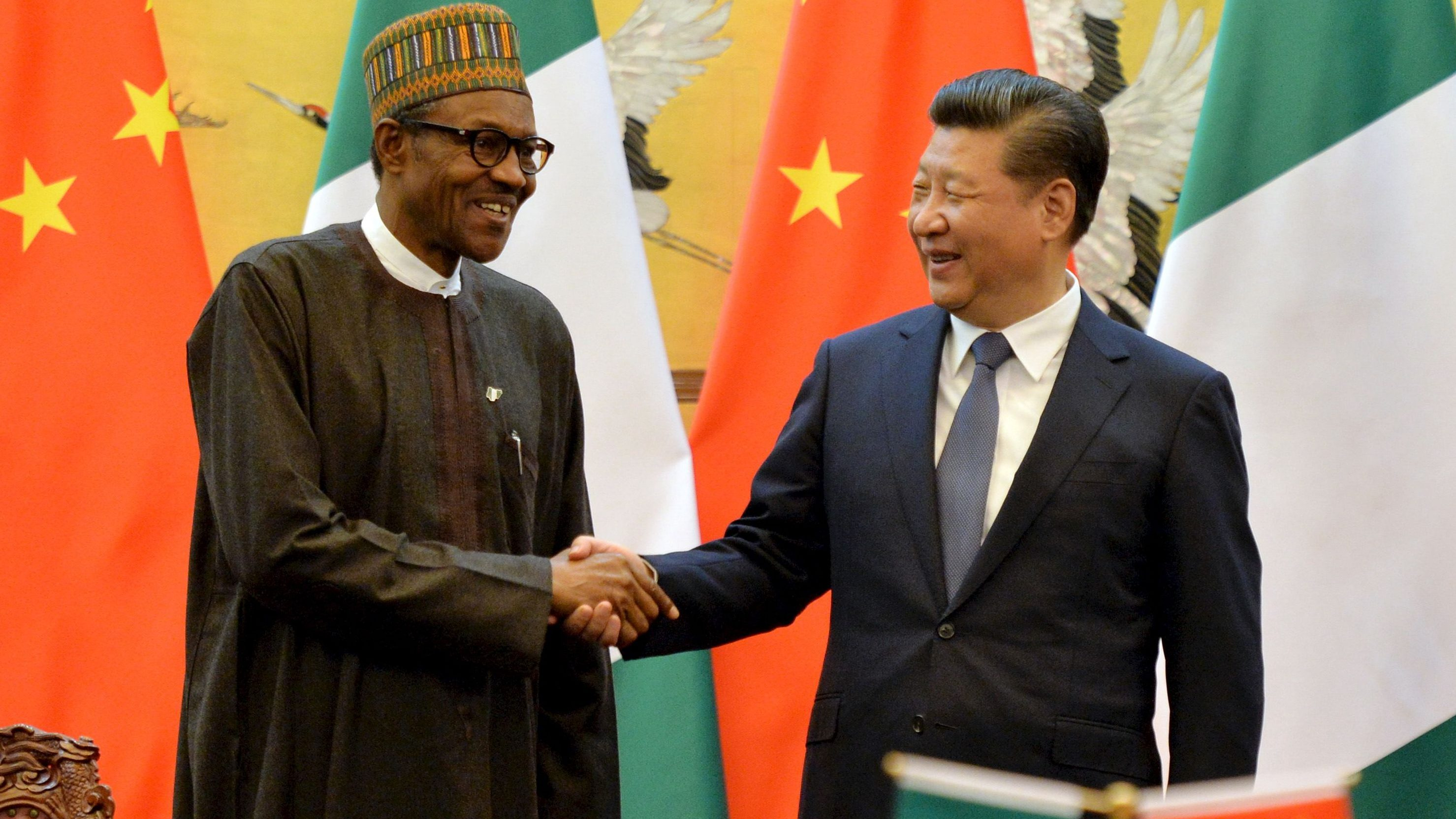 President of the Federal Republic of Nigeria, Muhammadu Buhari and Chinese President, Xi Jinping shake hands during a signing ceremony at the Great Hall of the People in Beijing