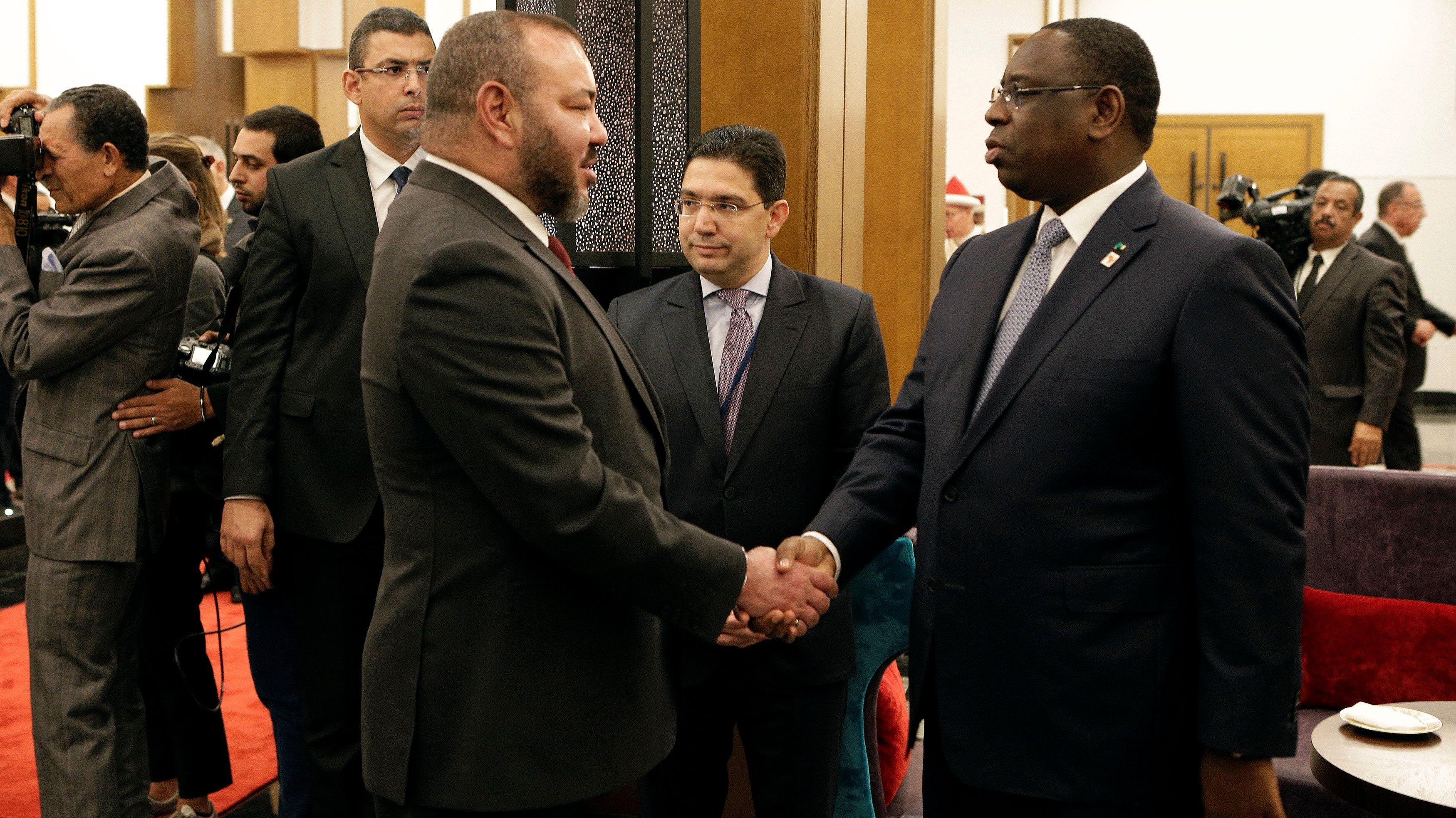 King Mohammed VI of Morocco (L) shakes hand with President of Senegal Macky Sall at the opening of the Africa Action Summit, on the sidelines of the UN Climate Change Conference 2016 (COP22) in Marrakech