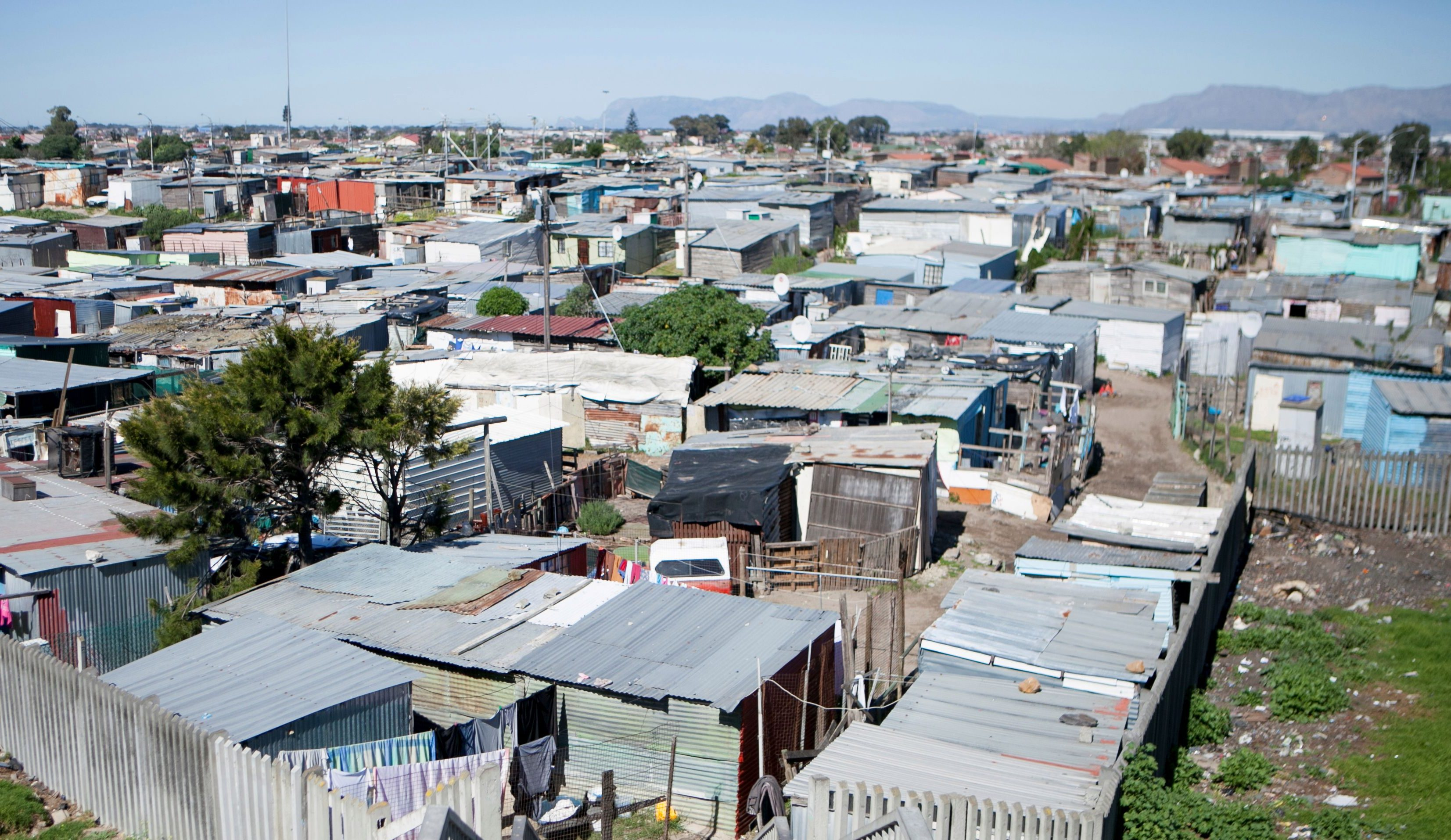 Shacks are seen at an informal settlement near Cape Town