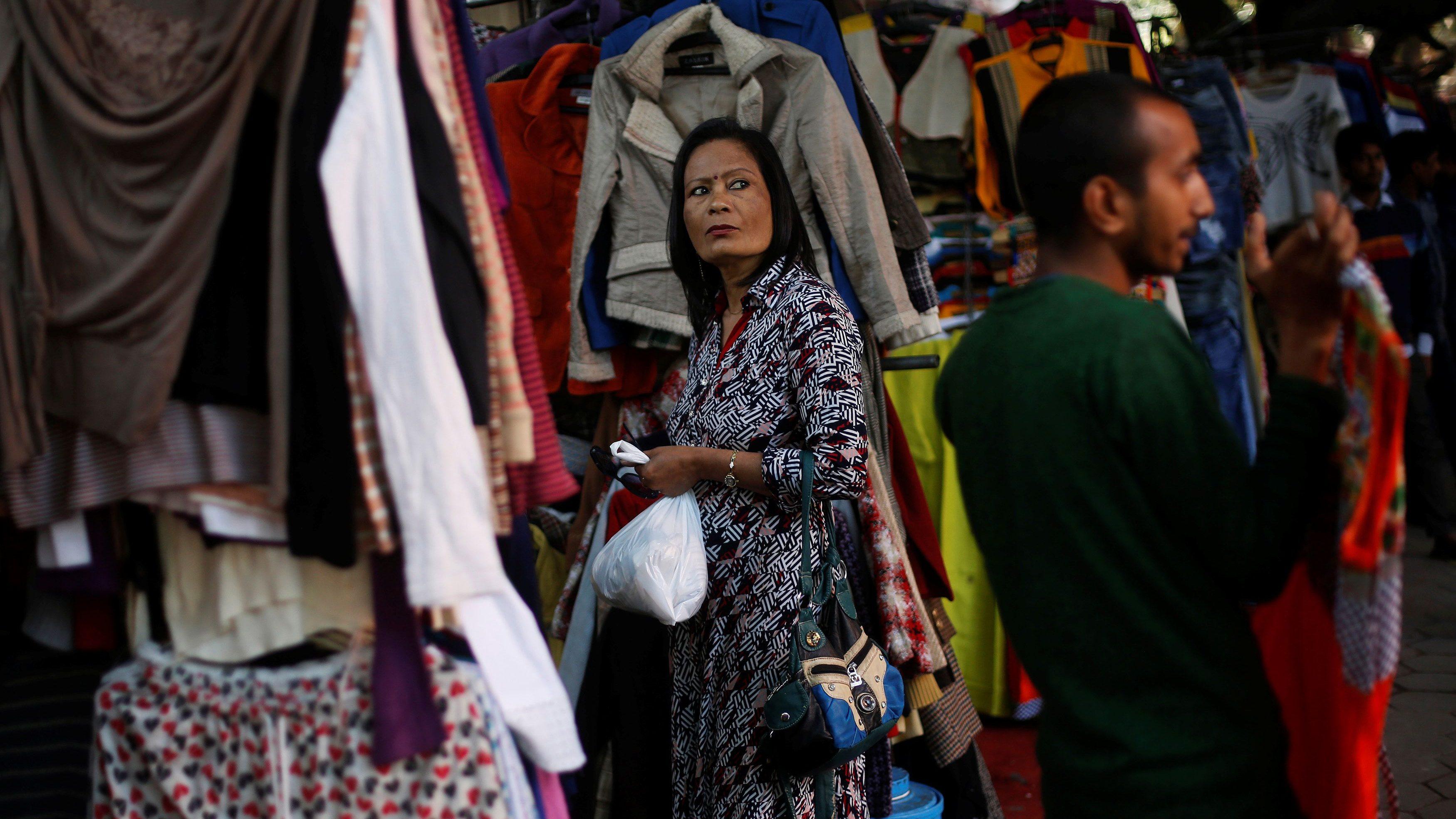 A woman buys clothes in a shop at a market in New Delhi, India, February 1, 2017. REUTERS/Adnan Abidi - RC1B62B9CA00