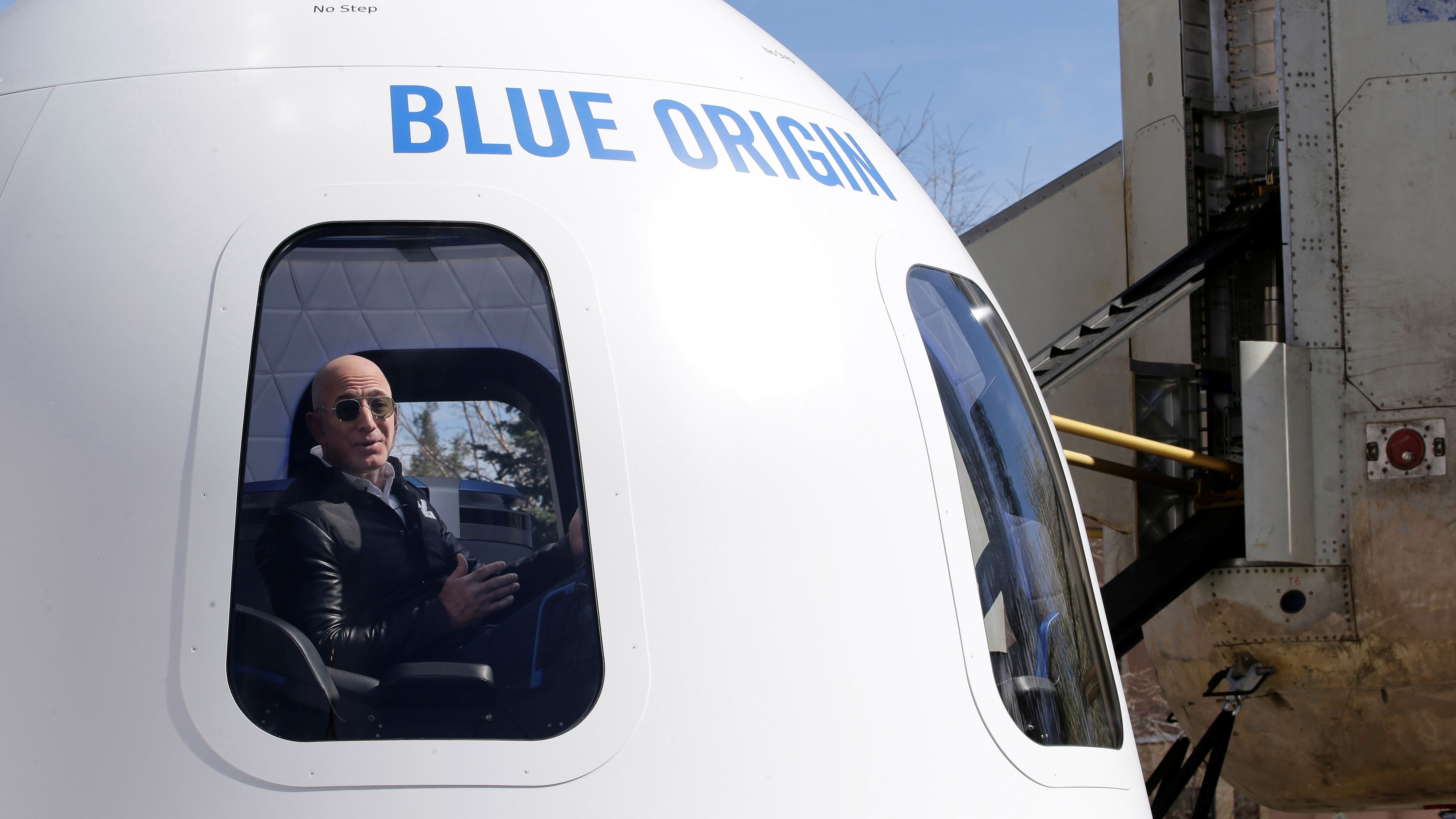 Amazon and Blue Origin founder Jeff Bezos addresses the media about the New Shepard rocket booster and Crew Capsule mockup at the 33rd Space Symposium in Colorado Springs, Colorado, United States April 5, 2017.  REUTERS/Isaiah J. Downing - RC1AE1C5E140