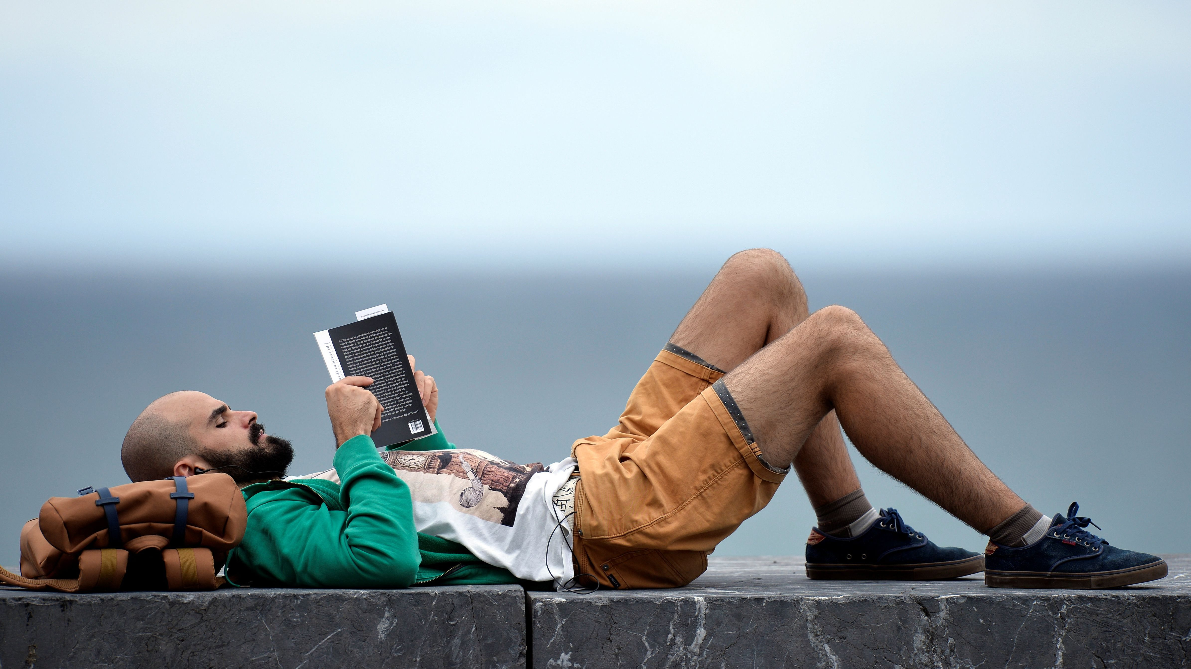 A man reads a book near a photocall at the San Sebastian Film Festival in San Sebastian, Spain, September 22, 2017.