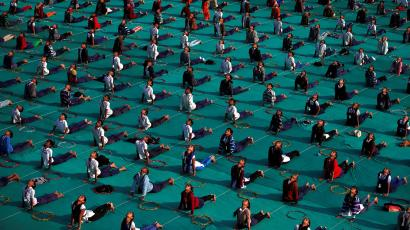 School children attend a yoga session on the last day of a week-long camp in Ahmedabad