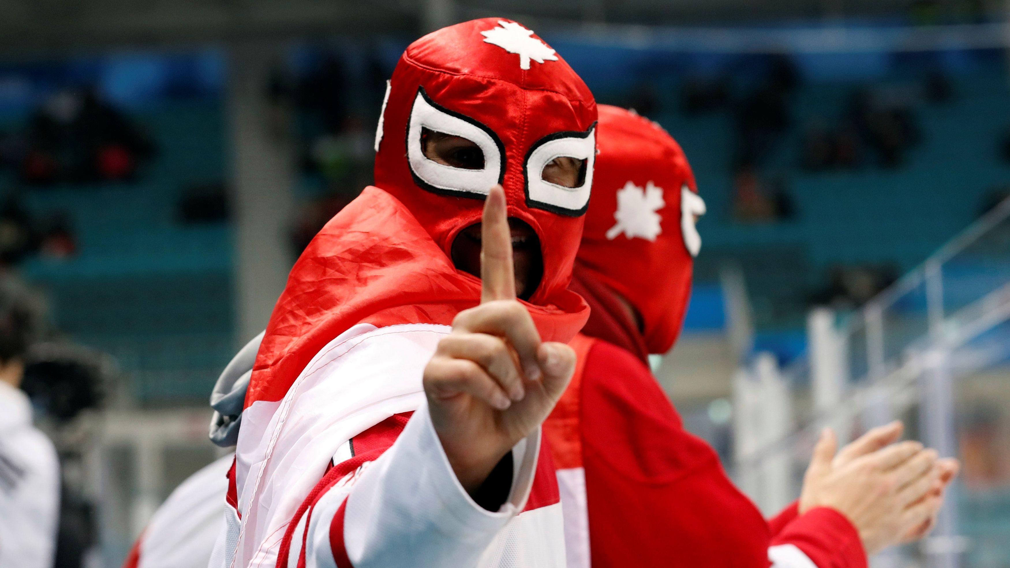 Ice Hockey - Pyeongchang 2018 Winter Olympics - Men Semifinal Match - Canada v Germany - Gangneung Hockey Centre, Gangneung, South Korea - February 23, 2018 - Fans of Team Canada react. REUTERS/Kim Kyung-Hoon - HP1EE2N0XI87O