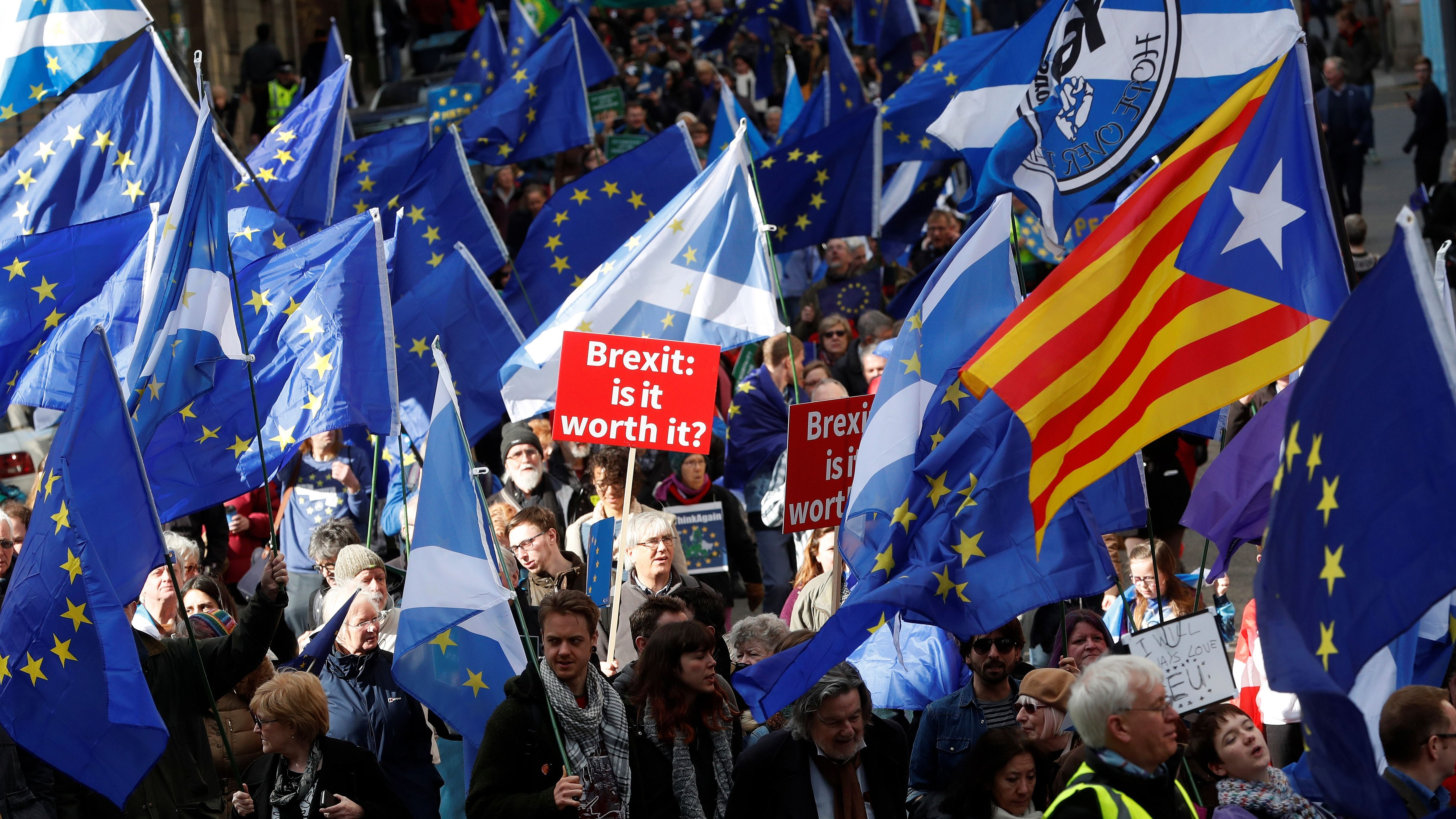 Protesters wave Saltires and EU flags as they take part in a demonstration to demand a vote on the Brexit deal between Britain and the European Union in Edinburgh, Scotland, March 24, 2018. REUTERS/Russell Cheyne - RC12526D81C0
