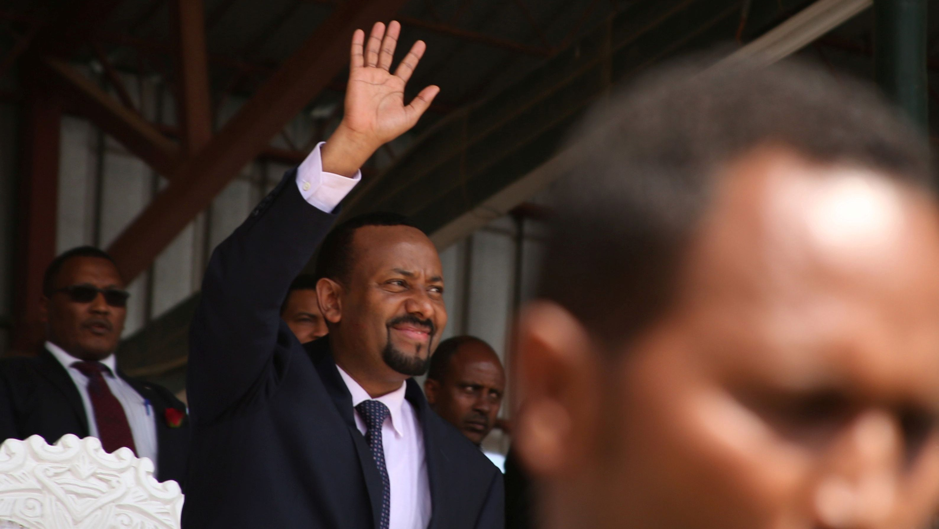 Ethiopia's newly elected prime minister Abiy Ahmed waves to the rally during his visit to Ambo in the Oromiya region, Ethiopia, April 11, 2018.