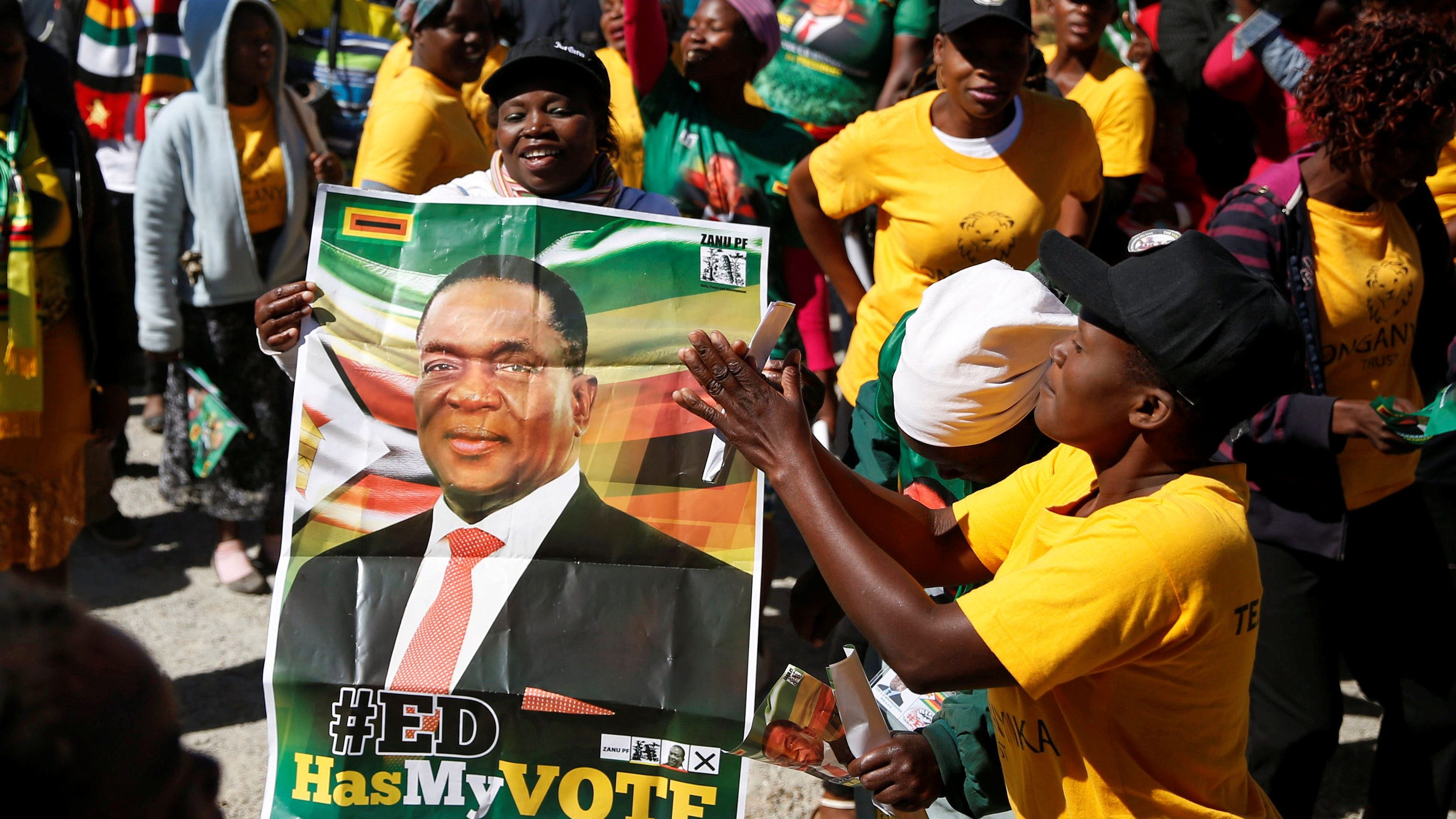 Supporters of President Emmerson Mnangagwa's ZANU PF party gather to march for non-violent, free and fair general elections in Harare