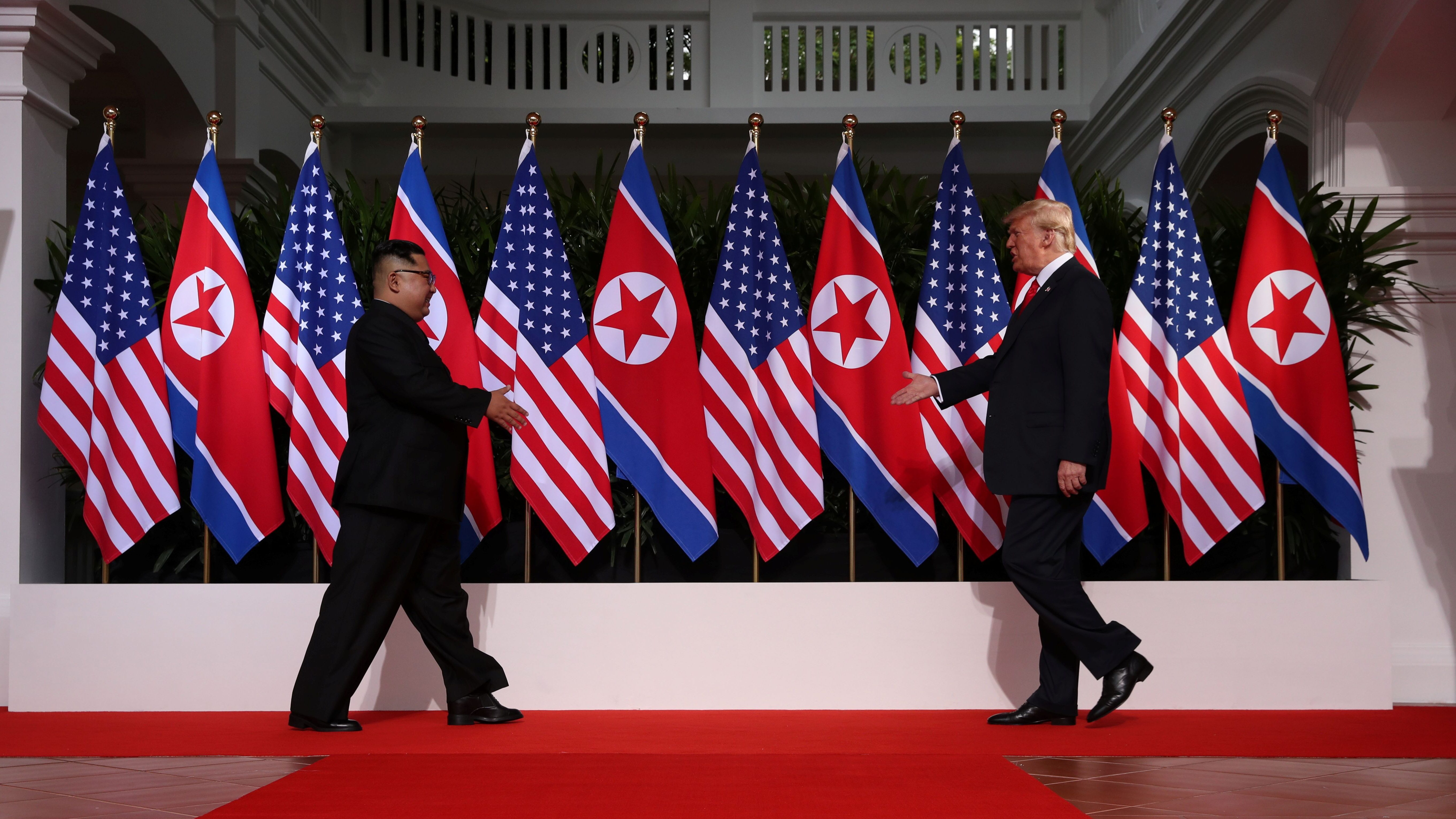 U.S. President Donald Trump and North Korean leader Kim Jong Un prepare to shake hands at the Capella Hotel on Sentosa island in Singapore June 12.