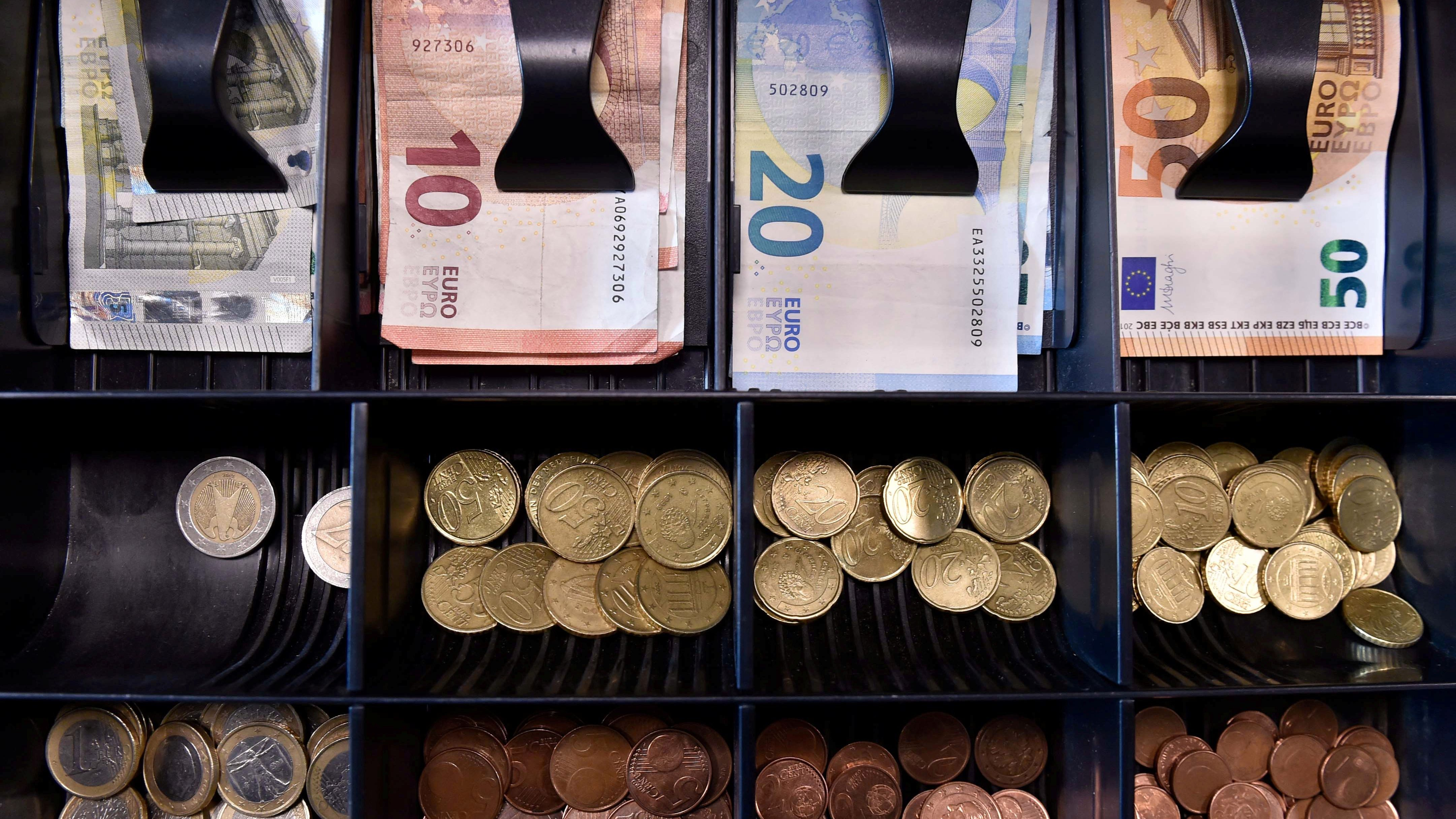FILE PHOTO: Euro banknotes and coins are displayed in a shop in Brussels