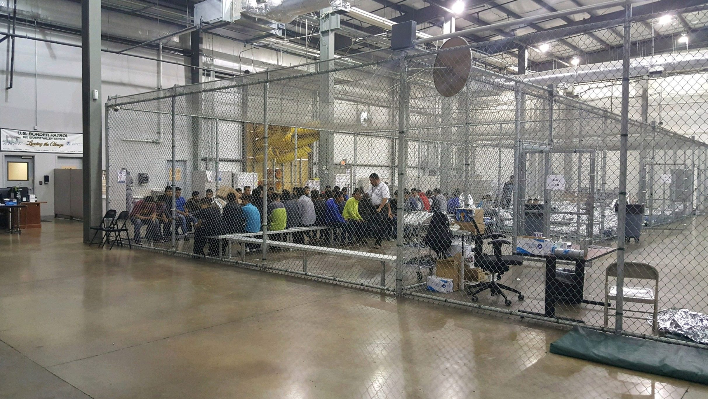 A view of inside U.S. Customs and Border Protection (CBP) detention facility shows detainees inside fenced areas at Rio Grande Valley Centralized Processing Center in Rio Grande City, Texas, U.S., June 17, 2018. Picture taken on June 17, 2018.   Courtesy CBP/Handout via REUTERS   ATTENTION EDITORS - THIS IMAGE HAS BEEN SUPPLIED BY A THIRD PARTY. - RC180F6BB600