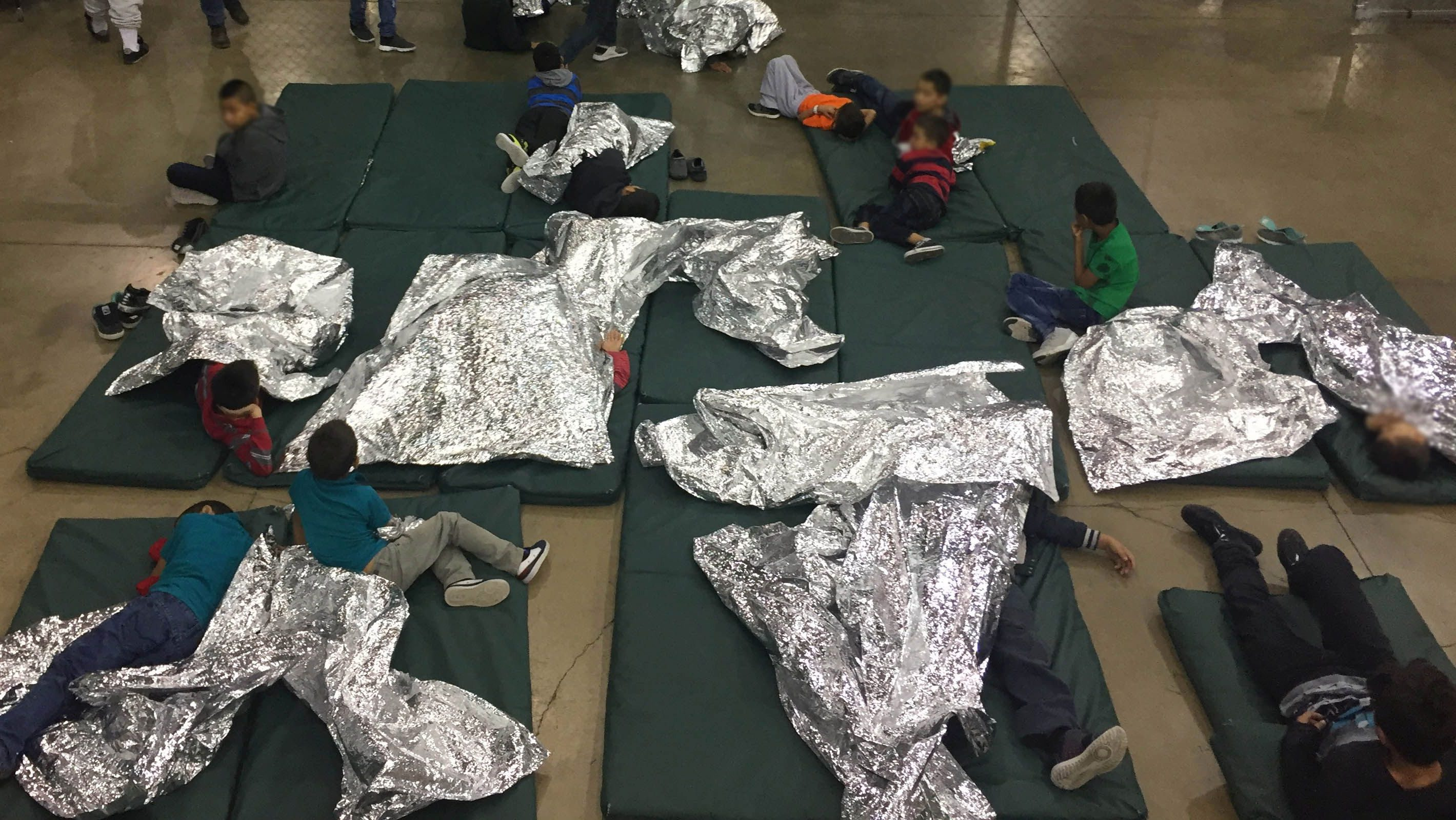 children inside U.S. Customs and Border Protection (CBP) detention facility shows children at Rio Grande Valley Centralized Processing Center