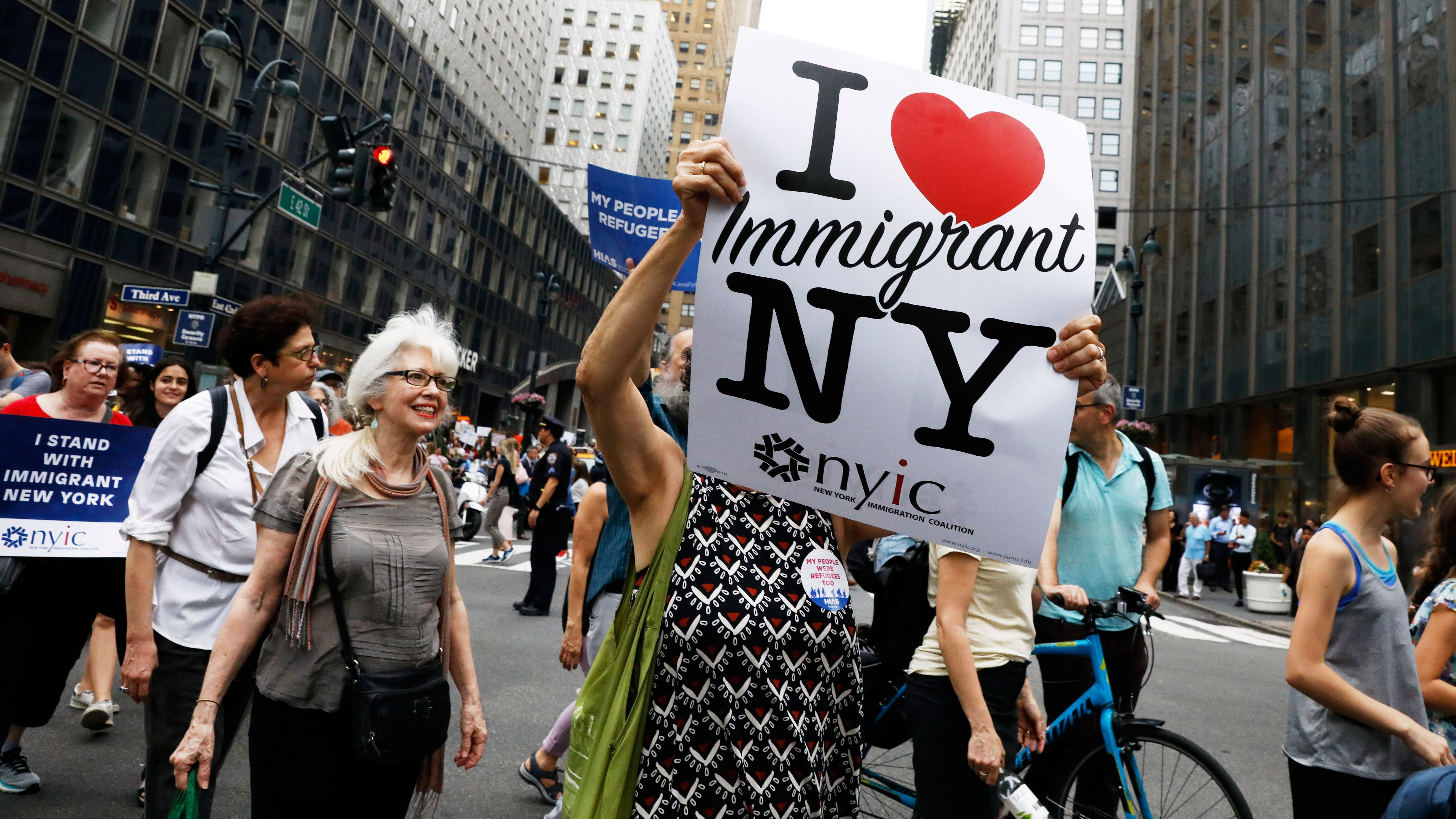 People march in protest against the Trump administration policy of separating immigrant families