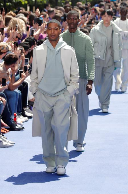 Kid Cudi presents a creation by designer Virgil Abloh as part of his Spring/Summer 2019 collection for Louis Vuitton fashion house during Men's Fashion Week in Paris, France, June 21, 2018. REUTERS/Charles Platiau - RC1BEB85D3D0