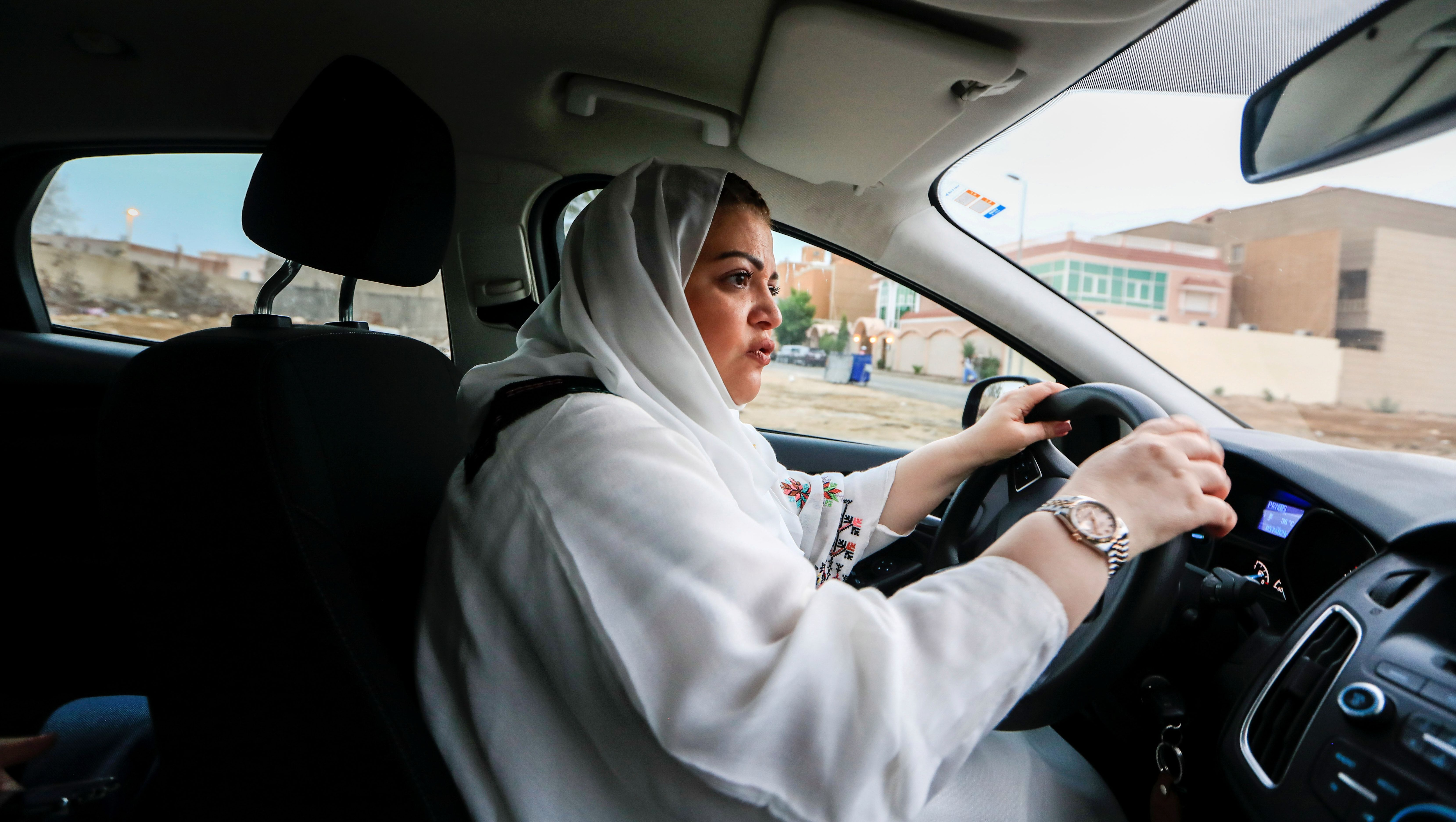 Dr Samira al-Ghamdi, 47, a practicing psychologist, drives around the side roads of a neighborhood as she prepares to hit the road on Sunday as a licensed driver, in Jeddah, Saudi Arabia June 21, 2018. Picture taken June 21, 2018. REUTERS/Zohra Bensemra - RC11CC6FE930