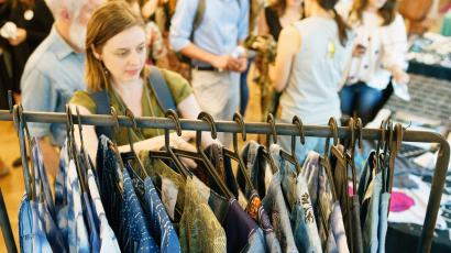 A woman shopping at refugee creator night