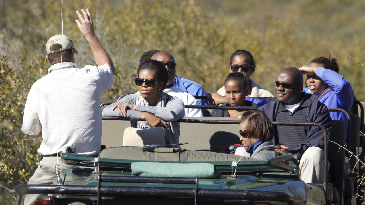 U.S. first lady Michelle Obama daughters Sasha and Malia, mother Marian Robinson listen to their guide during a safari in Madikwe Game Reserve in South Africa, Saturday, June 25, 2011. (AP Photo/Charles Dharapak, Pool)