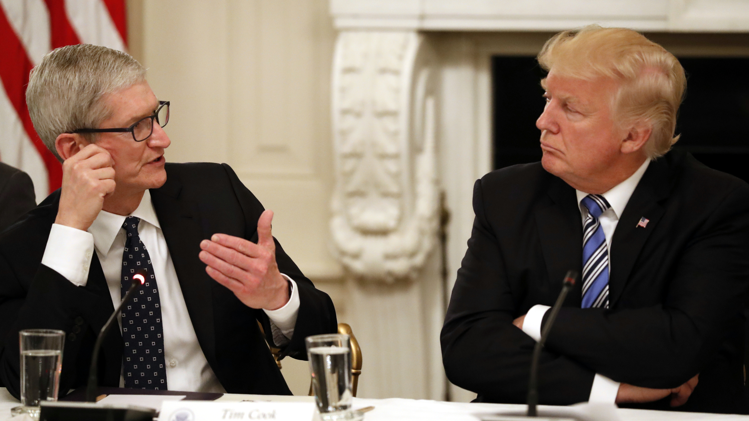 Tim Cook, Chief Executive Officer of Apple, left, speaks as President Donald Trump, listens during an American Technology Council roundtable in the State Dinning Room of the White House, Monday, June 19, 2017, in Washington.