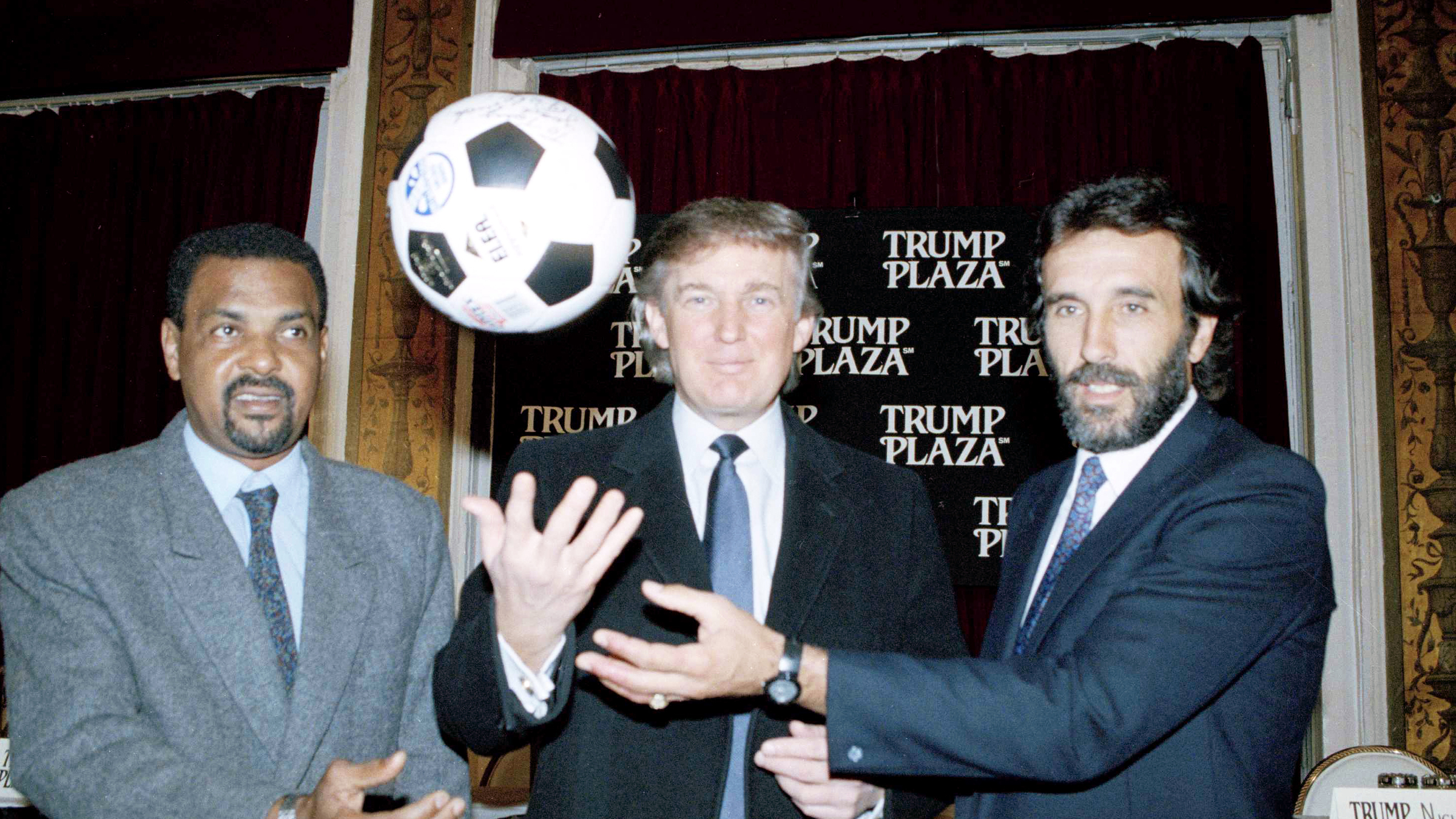 Real estate magnate Donald Trump is flanked by soccer players Luis Pereira, left, of Brazil, and Julio Villa of Argentina, during a news conference in New York, Jan. 29, 1992. Argentina and Brazil will meet in an exhibition Futbol 5 match at Trump Plaza Hotel and Casino in Atlantic City, N.J., March 28, 1992.
