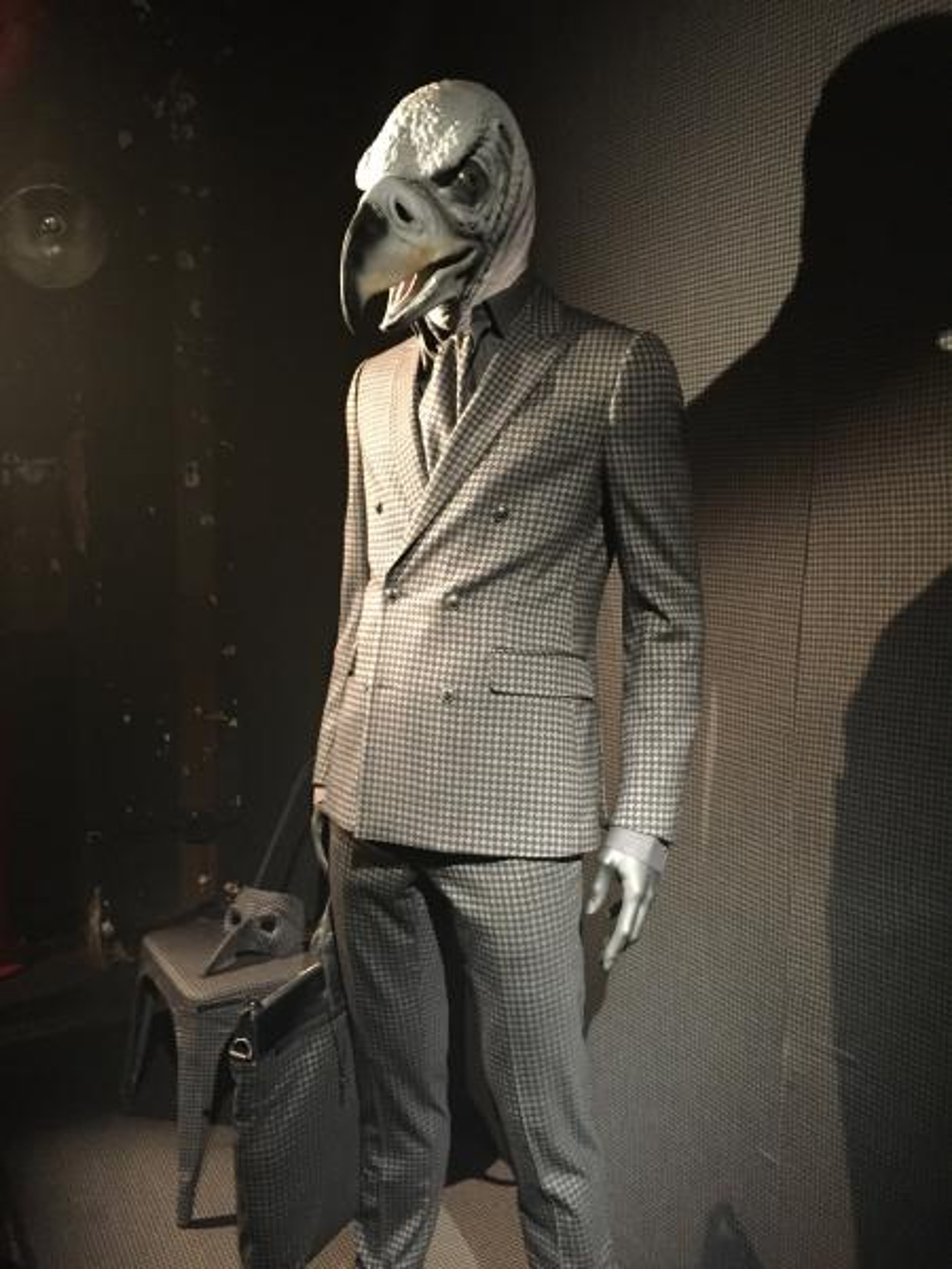 A mannequin in an animal mask wears designer John Varvatos' Men's Fall/Winter 2016 fashion.