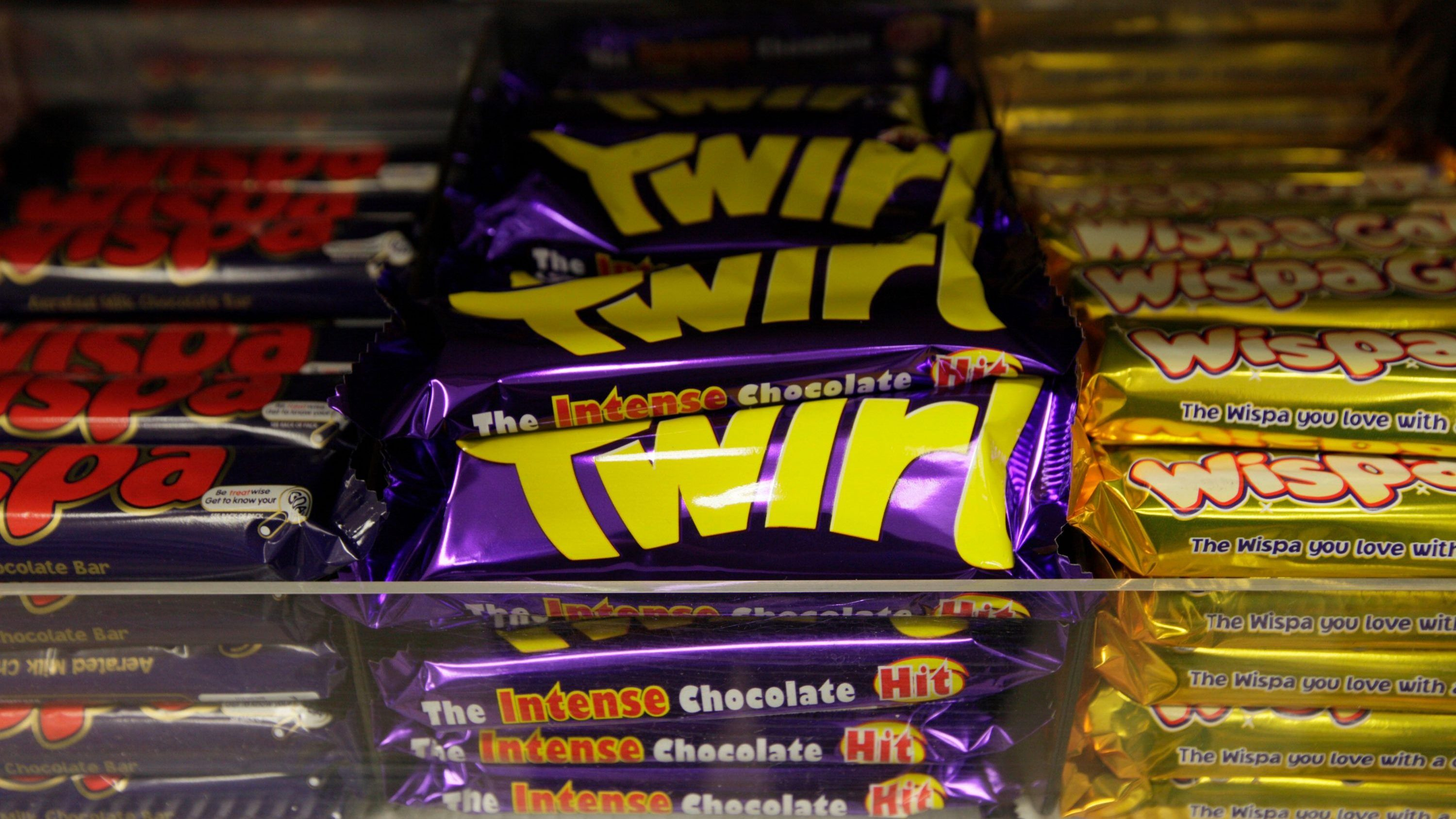 Cadbury chocolate bars are seen on a supermarket's shelves in central London, Monday Nov. 9, 2009.  Kraft Foods Inc. has launched a 9.8 billion pound (US$16.4 billion) hostile bid for Cadbury PLC _ refusing to sweeten a previous offer rejected by the British candy maker.