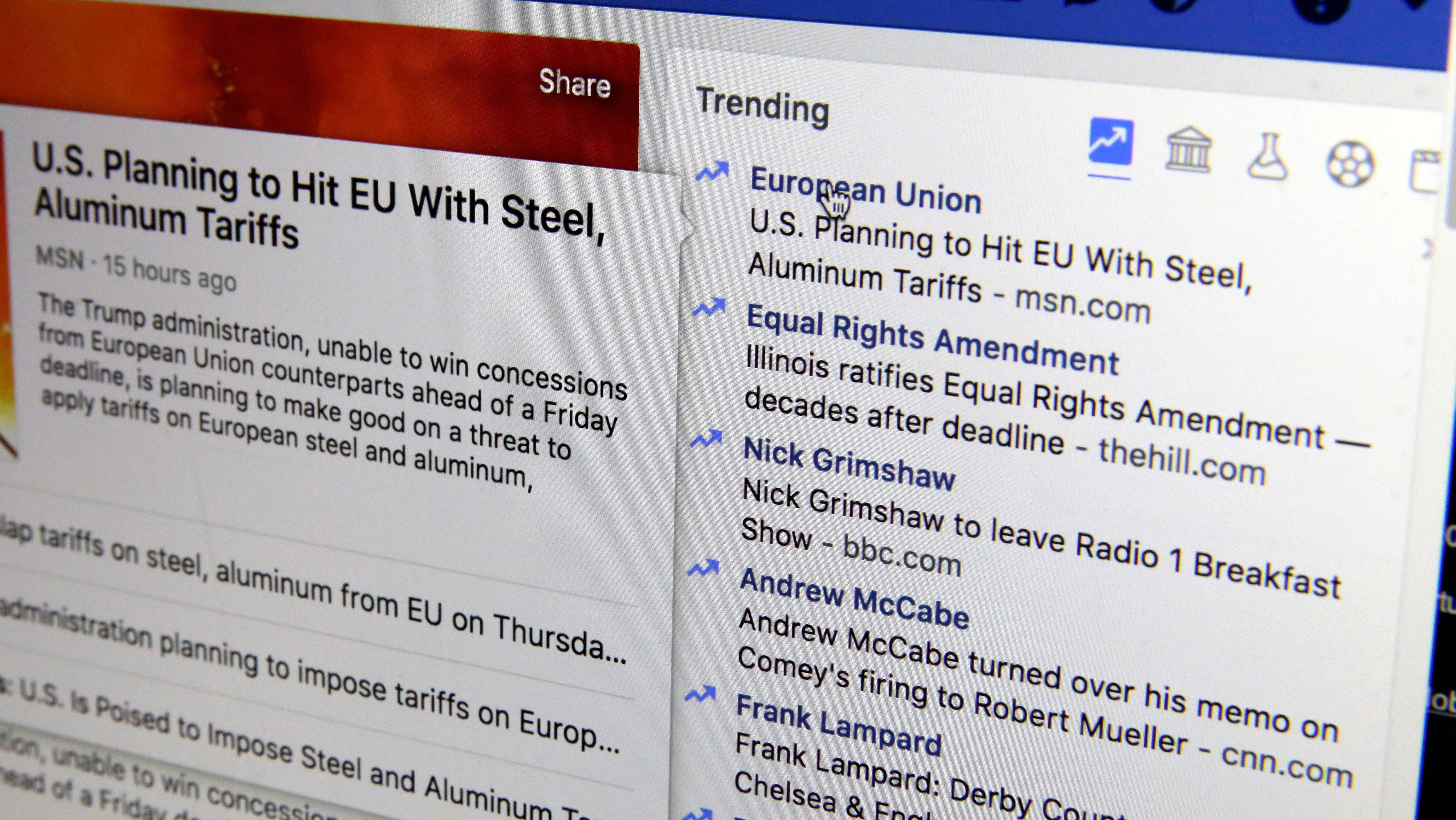 """This Thursday, May 31, 2018, photo shows the Trending section on a Facebook account in New York.   Facebook is shutting down its ill-fated """"trending"""" news section after four years, a company executive told The Associated Press. The company claims the tool is outdated and wasn't popular. But the trending section also proved problematic in ways that would presage Facebook's later problems with fake news, political balance and the limitations of artificial intelligence in managing the messy human world. (AP Photo/Richard Drew)"""