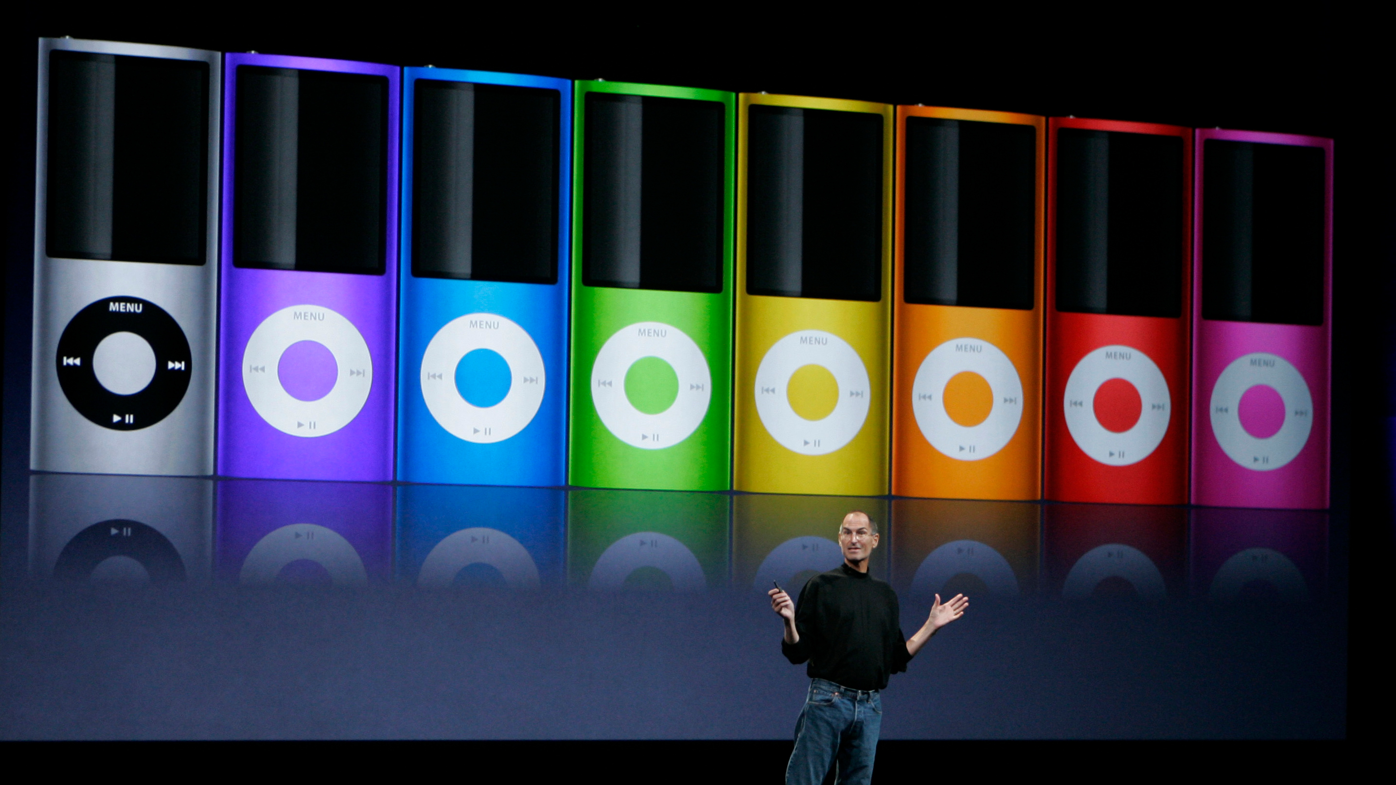 Apple CEO Steve Jobs introduces new colors of the new iPod Nano during a product announcement in San Francisco, Tuesday, Sept. 9, 2008. (AP Photo/Paul Sakuma)
