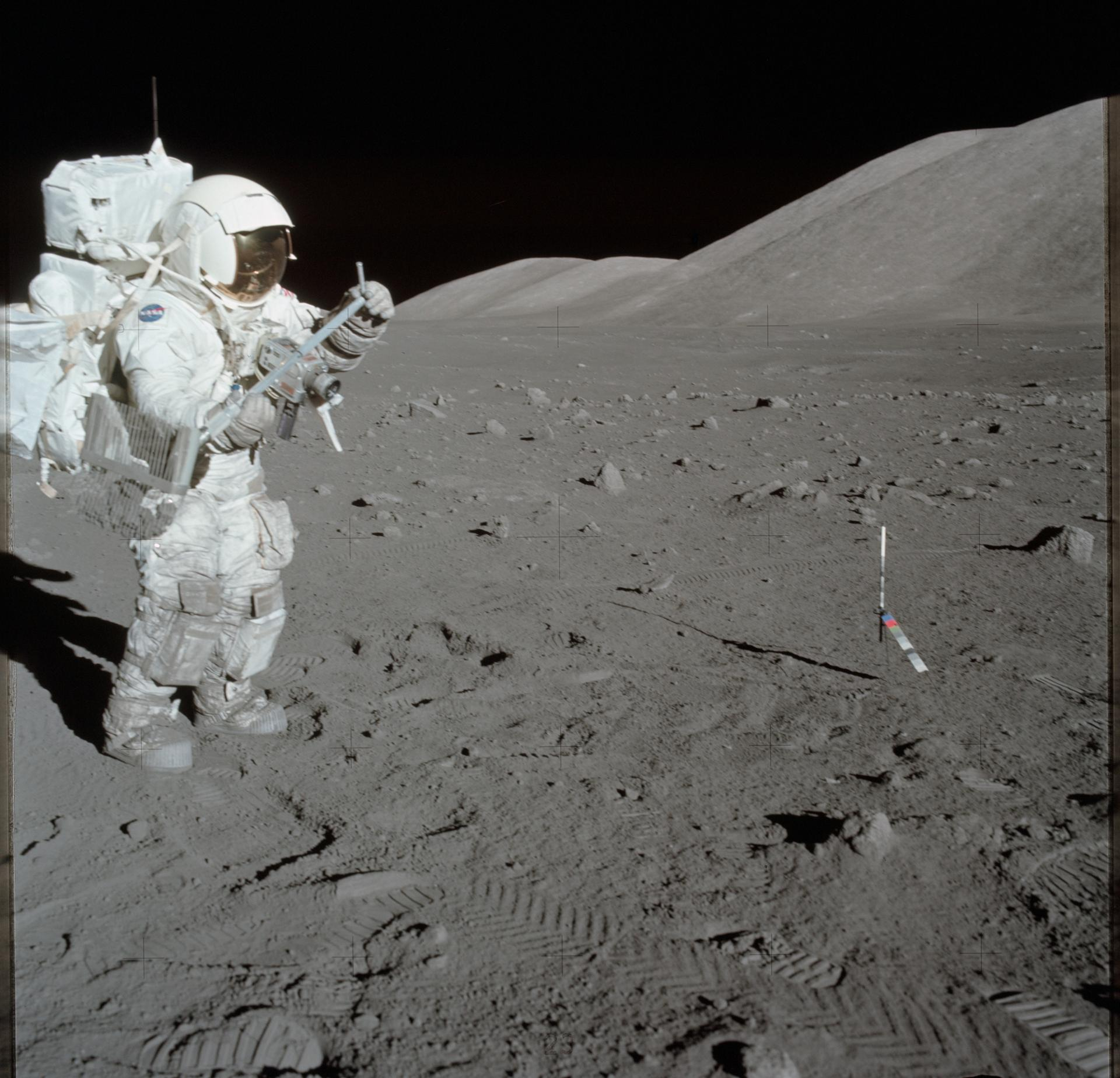 AS17-134-20426 (11 Dec. 1972) --- Scientist-astronaut Harrison H. Schmitt collects lunar rake samples at Station 1 during the first Apollo 17 extravehicular activity (EVA) at the Taurus-Littrow landing site. This picture was taken by astronaut Eugene A. Cernan, Apollo 17 commander. Schmitt is the lunar module pilot. The Lunar Rake, an Apollo Lunar Geology Hand Tool, is used to collect discrete samples of rocks and rock chips ranging in size from one-half inch (1.3 cm) to one inch (2.5 cm).