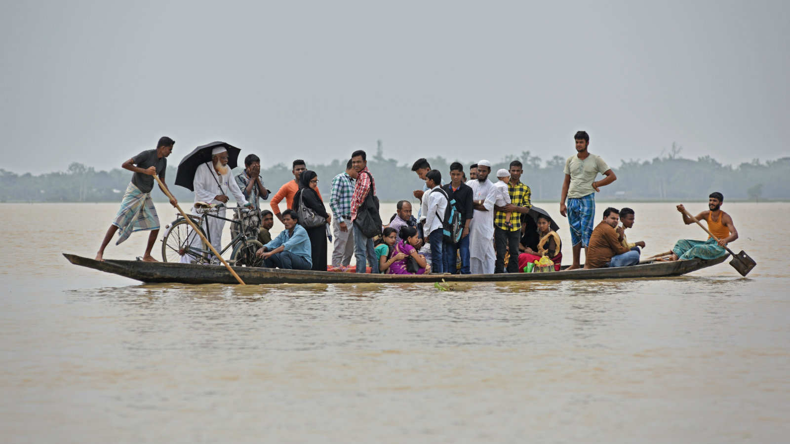 Flood affected villagers are transported in a boat to a safer place in Hojai district, in the northeastern state of Assam, India, June 17, 2018.