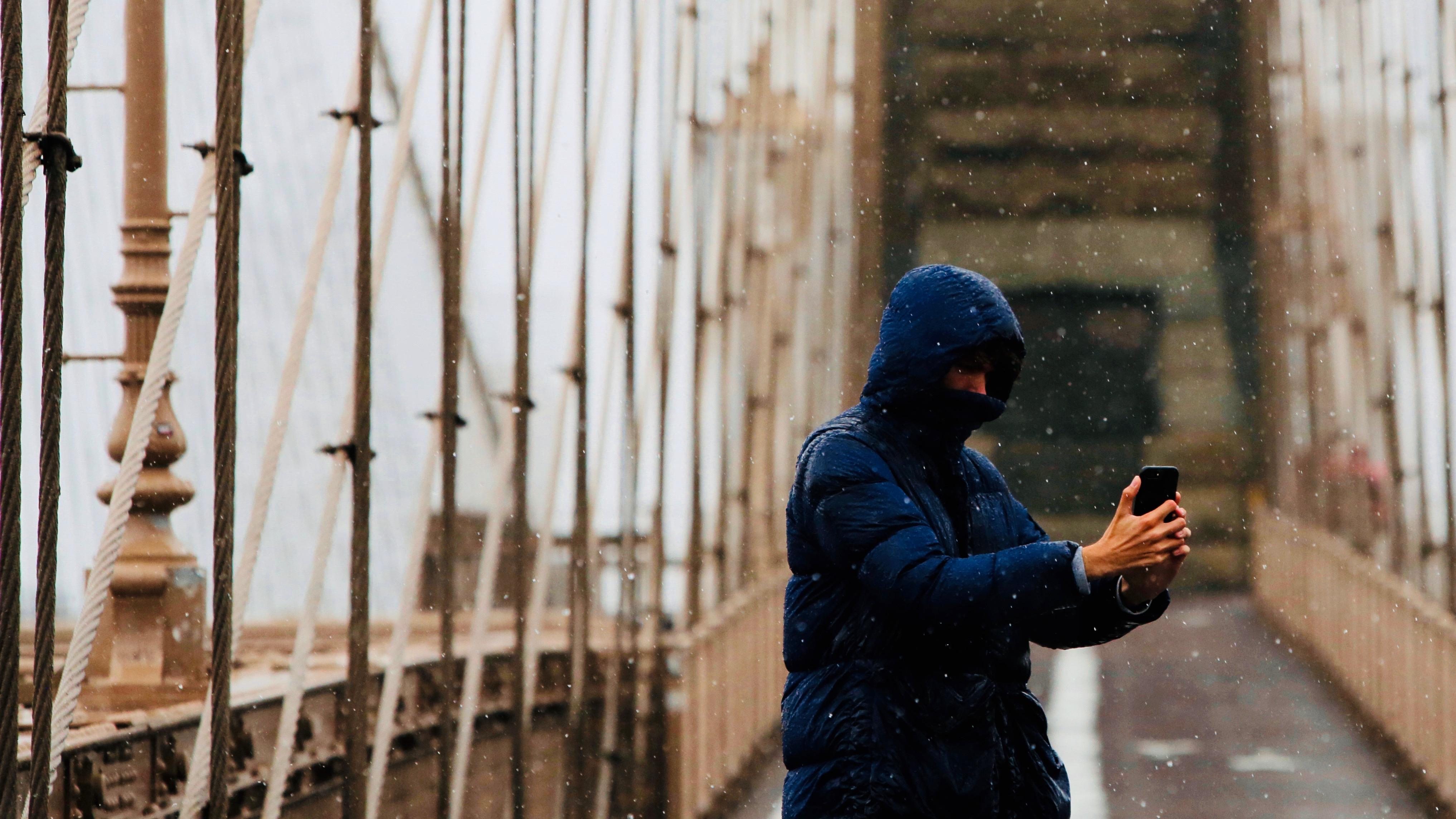 Cellphone on the Brooklyn Bridge.
