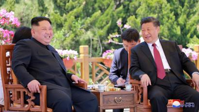 North Korean leader Kim Jong-un (L) laughing with Chinese President Xi Jinping (R) during their meeting in Dalian, China, 08 May 2018 (issued 09 May 2018).