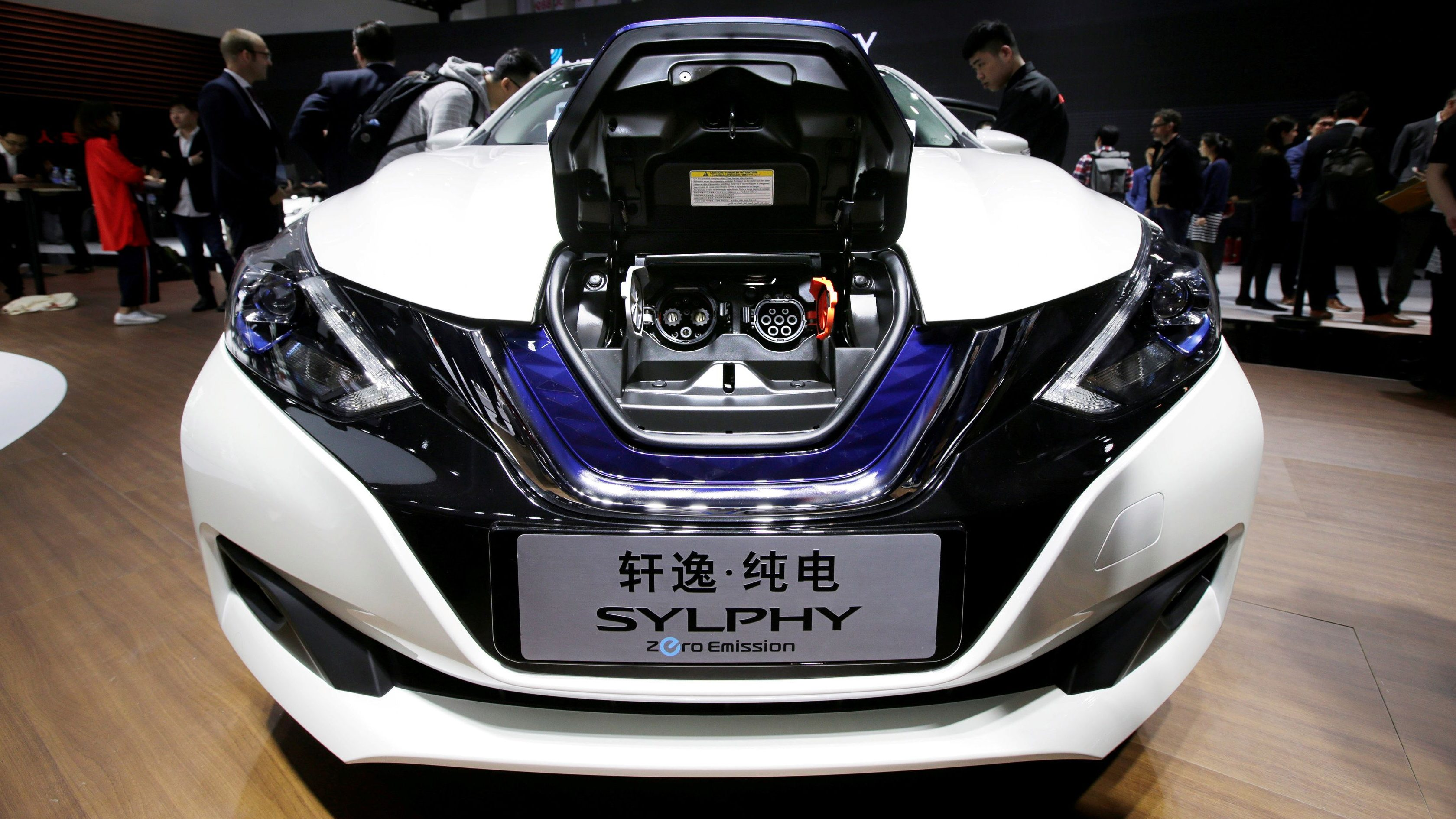 FILE PHOTO: A Nissan SYLPHY electric car is displayed during a media preview of the Auto China 2018 motor show in Beijing