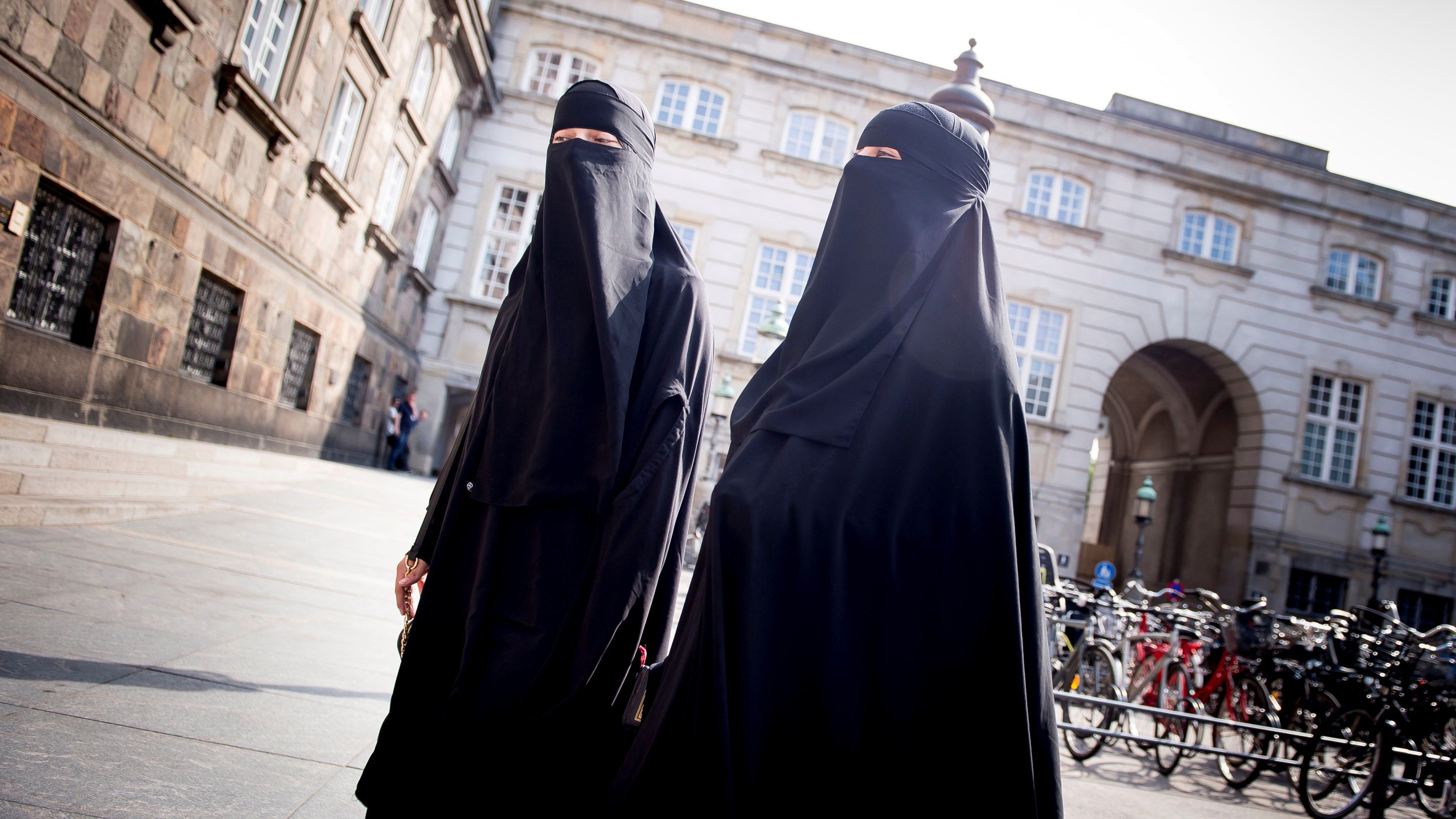 Women in niqab are pictured after the Danish Parliament banned the wearing of face veils in public, at Christiansborg Palace in Copenhagen, Denmark, May 31, 2018.