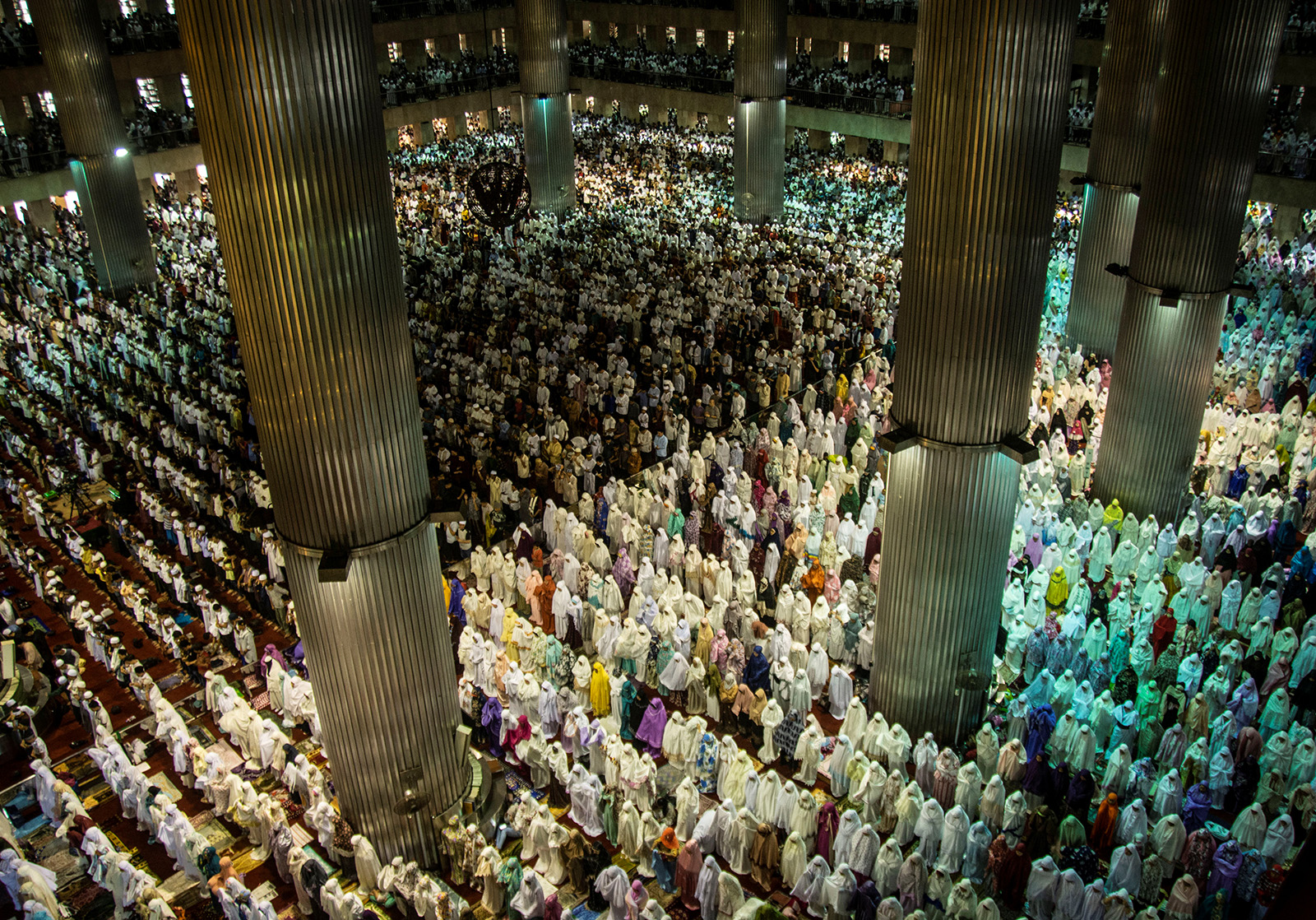 Muslims perform prayers for  Eid al-Fitr  at Istiqlal Mosque, Jakarta