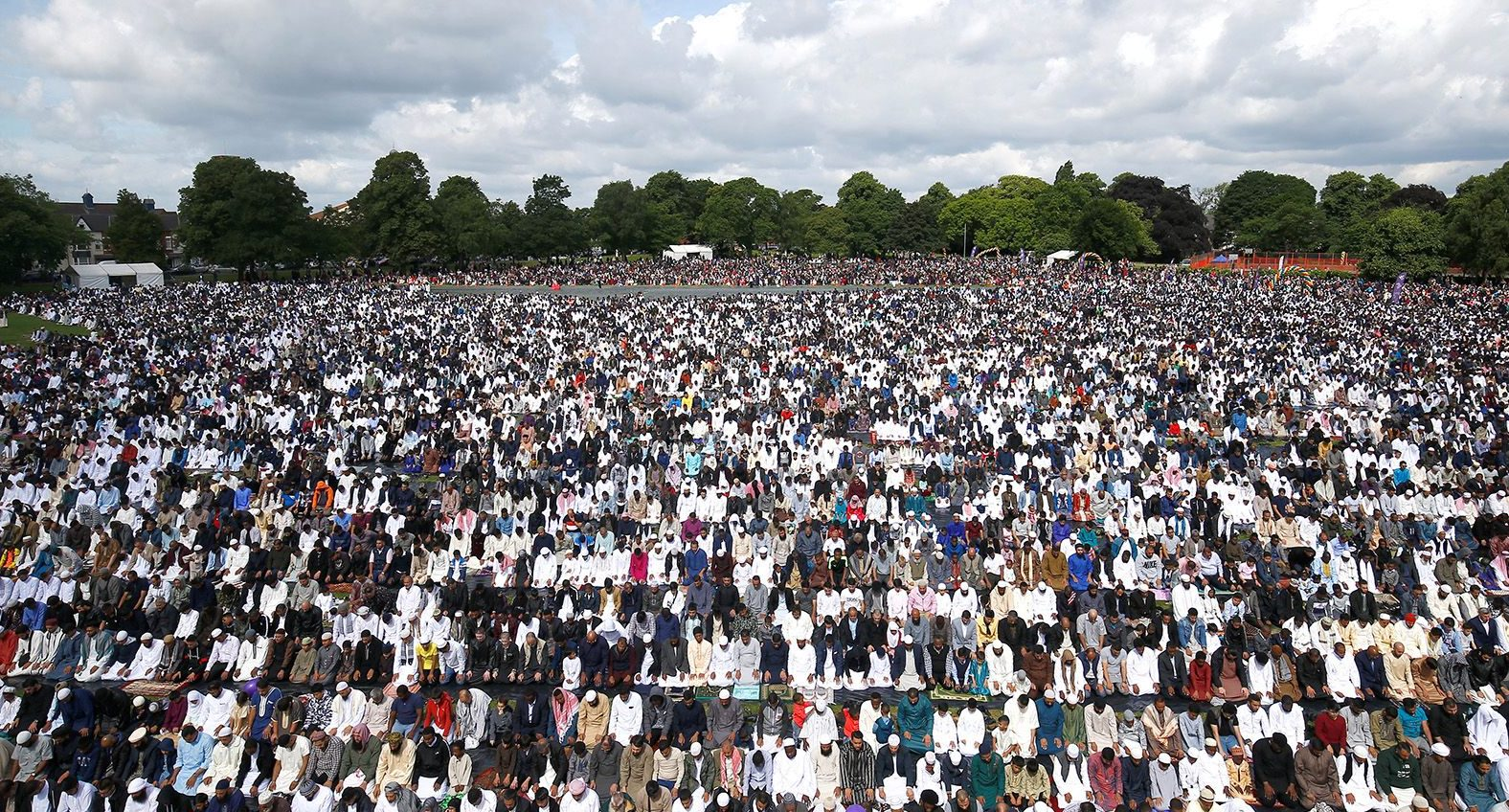 Around 140,000 muslims attend Eid al-Fitr prayers to mark the end of Ramadan, in Small Heath Park in Birmingham