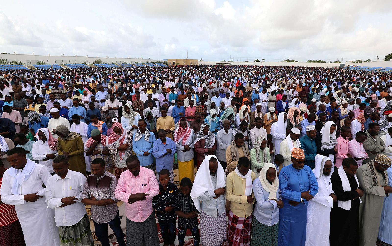 Muslim faithful attend Eid al-Fitr prayers to mark the end of the holy fasting month of Ramadan inside the soccer stadium in Hodan district of Mogadishu