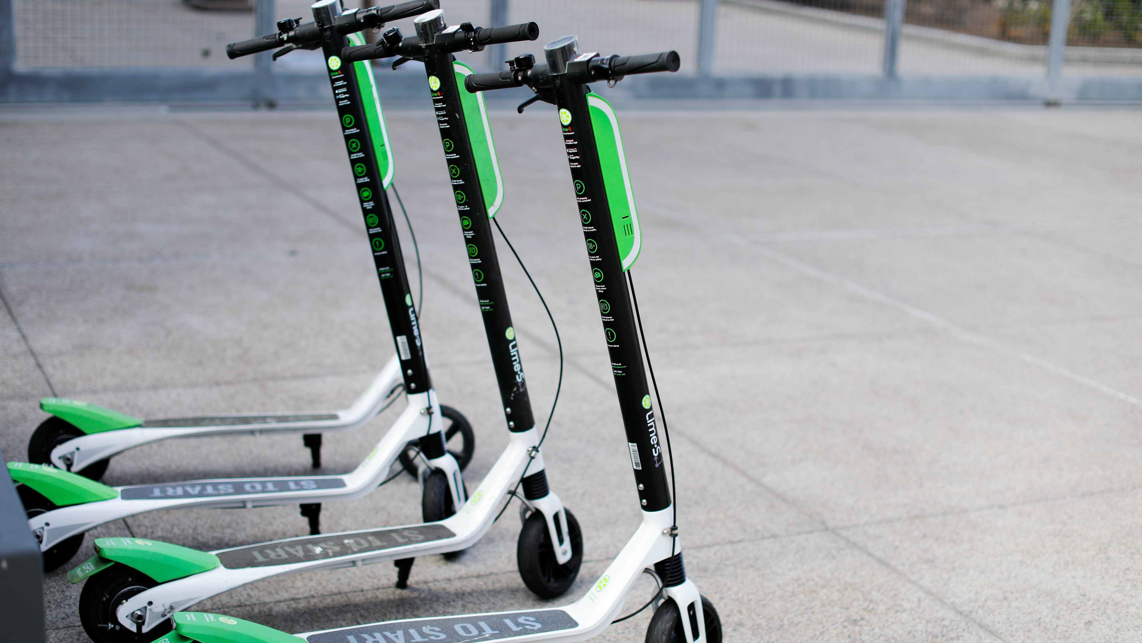 Smart phone app time-of-use electric scooters from Lime-S are shown parked along a sidewalk in San Diego, California, U.S.
