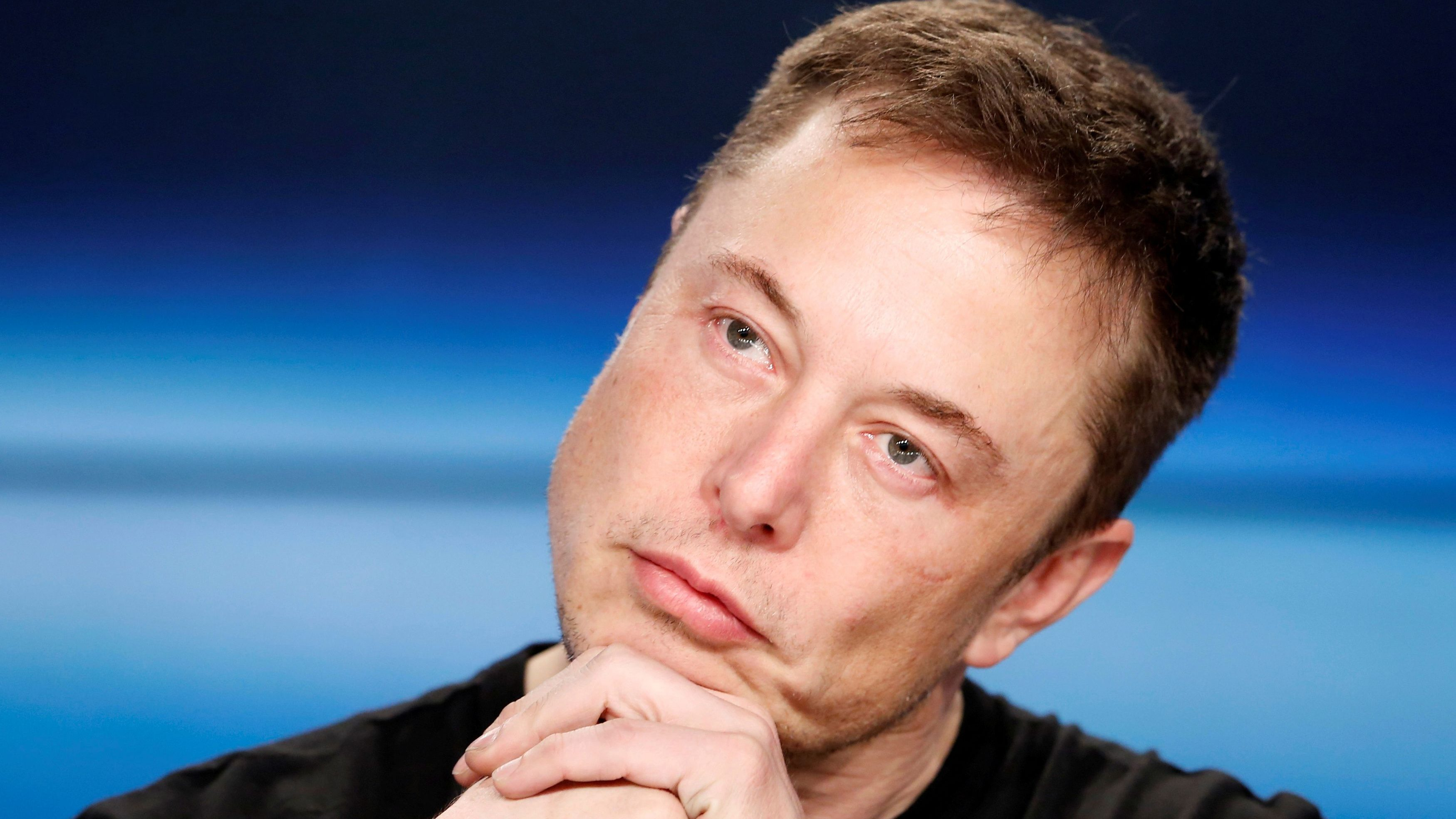 Elon Musk listens at a press conference following the first launch of a SpaceX Falcon Heavy rocket at the Kennedy Space Center in Cape Canaveral, Florida, U.S., February 6, 2018.