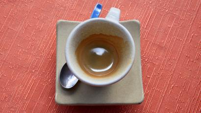 An empty coffee cup seen from above