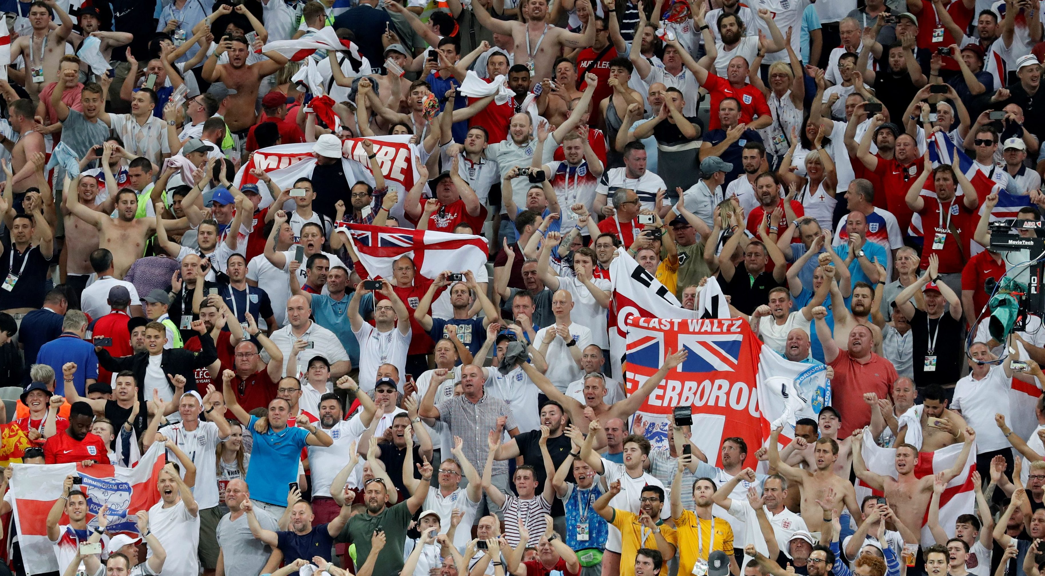 England fans celebrate victory after the match