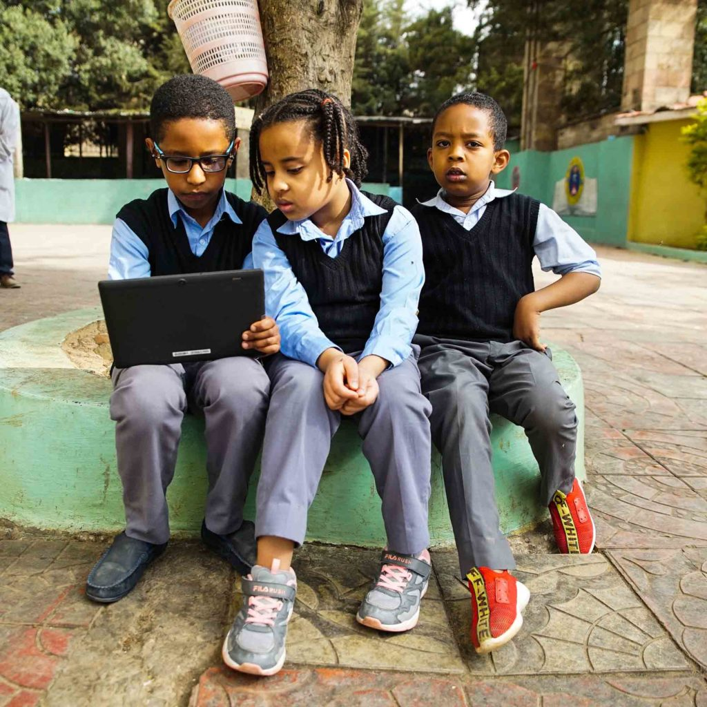 School children learn to count with YaNetu, and AI-driven teaching tablet.