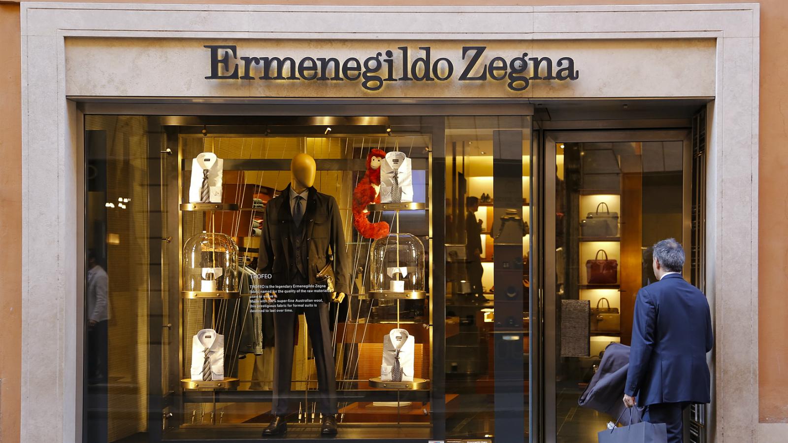 A man walks enters a Ermenegildo Zegna shop in downtown Rome, Italy February 10, 2016.
