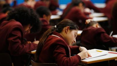 Pupils take a GCSE mathematics exam at the Harris Academy South Norwood in south east London, March 2, 2012