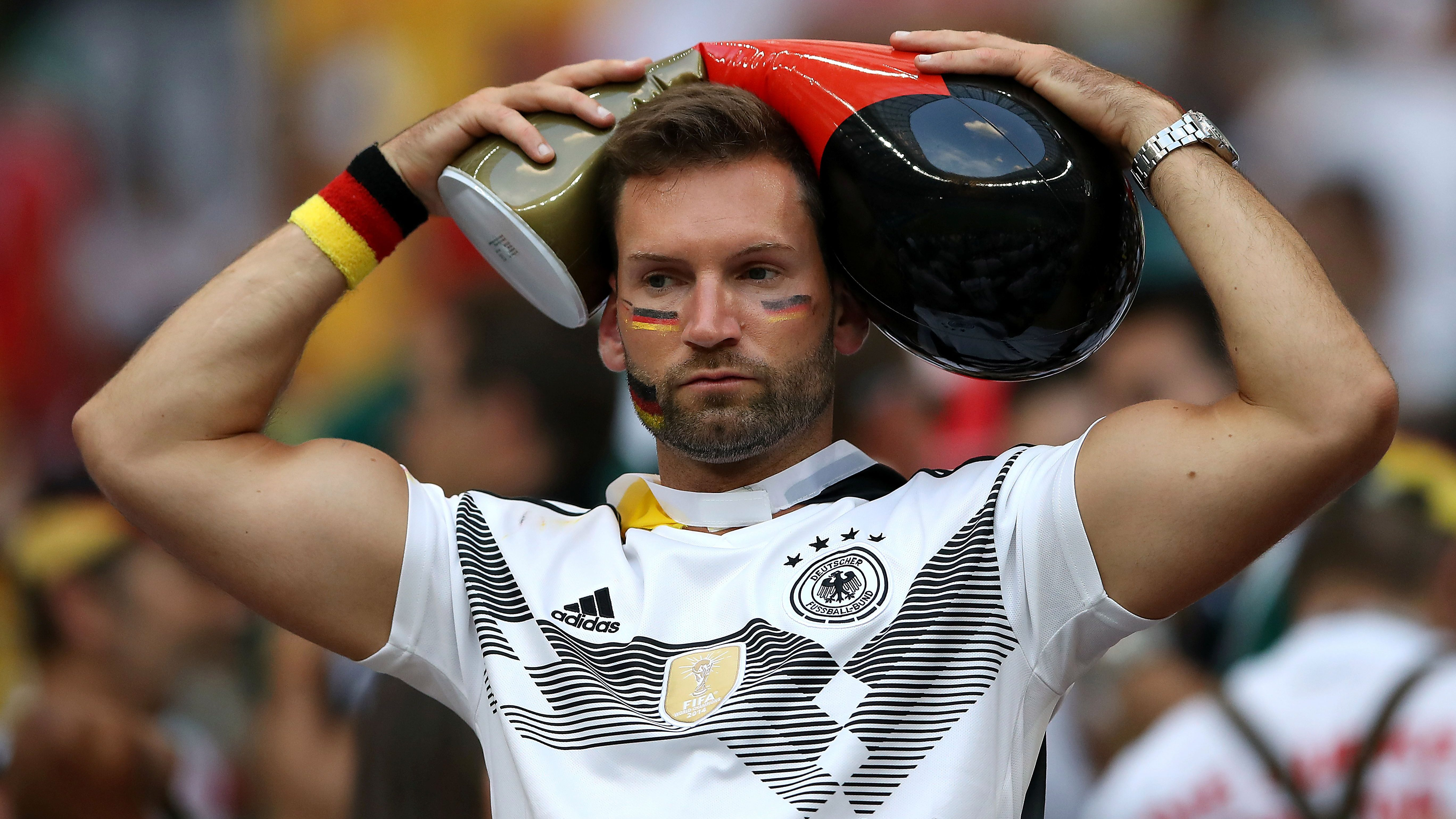 Germany fan looks dejected after the match