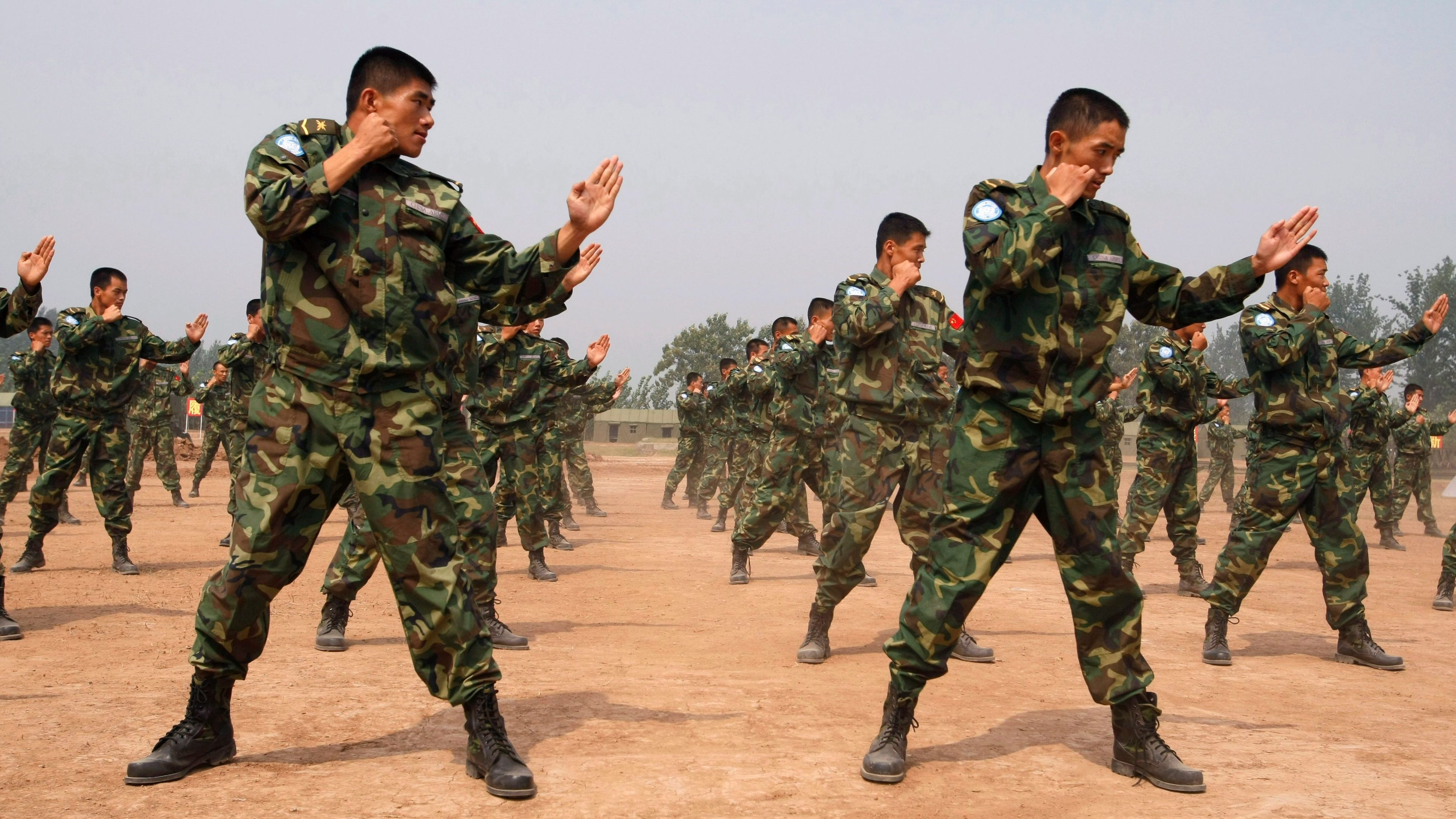 People's Liberation Army (PLA) soldiers deployed for United Nations (UN) peacekeeping missions give a demonstration of their engineering and combat skills at a military base in Qinyang, Henan province, China, 15 September 2007.  China will send a 315-member engineering unit of peacekeeping soldiers to the Darfur region of Sudan.  The unit will start to be dispatched in the beginning of October 2007 with the primary task of building and maintaining roads, helipads, bridges and barracks.  There are currently 1,648 Chinese officers and soldiers serving in 10 UN missions and the UN Department of Peacekeeping Operations (DPKO).