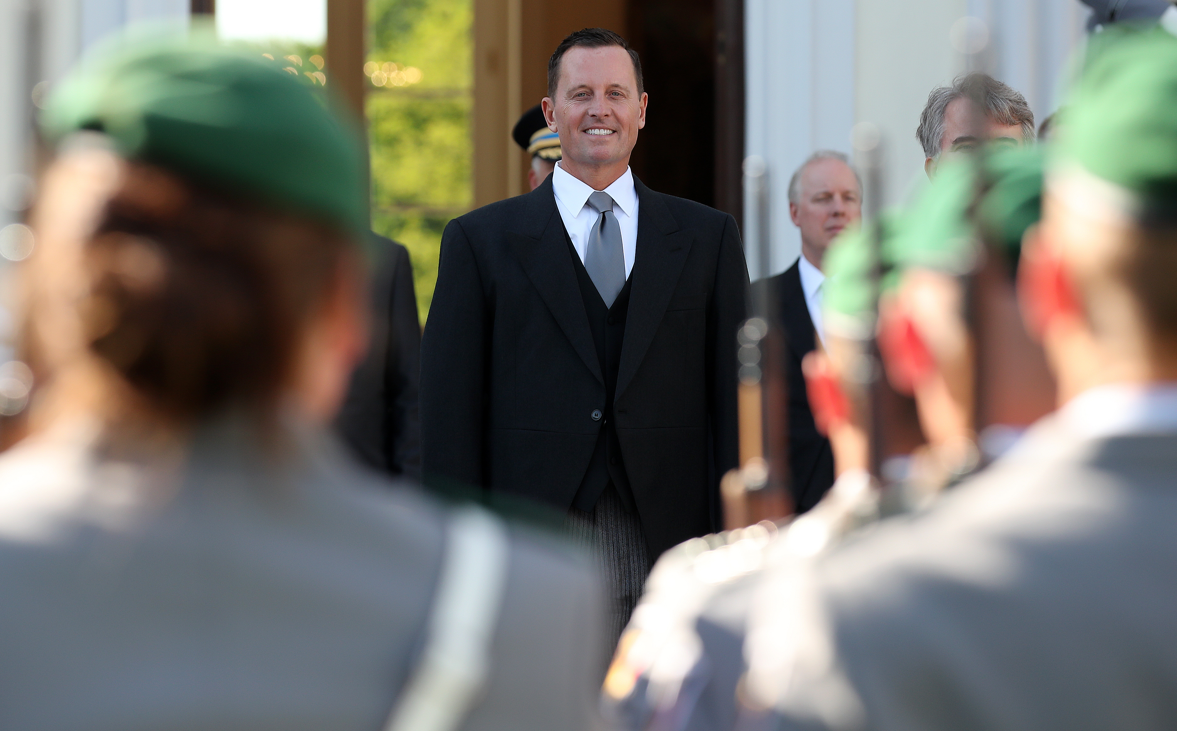 epa06719536 The new US Ambassador to Germany, Richard Allen Grenell (C) stands in front of the Guard of Honour after his diplomatic accreditation ceremony at Bellevue Palace in Berlin, Germany, 08 May 2018. The position of US Ambassador to Germany was left vacant for more than one year.  EPA-EFE/FELIPE TRUEBA