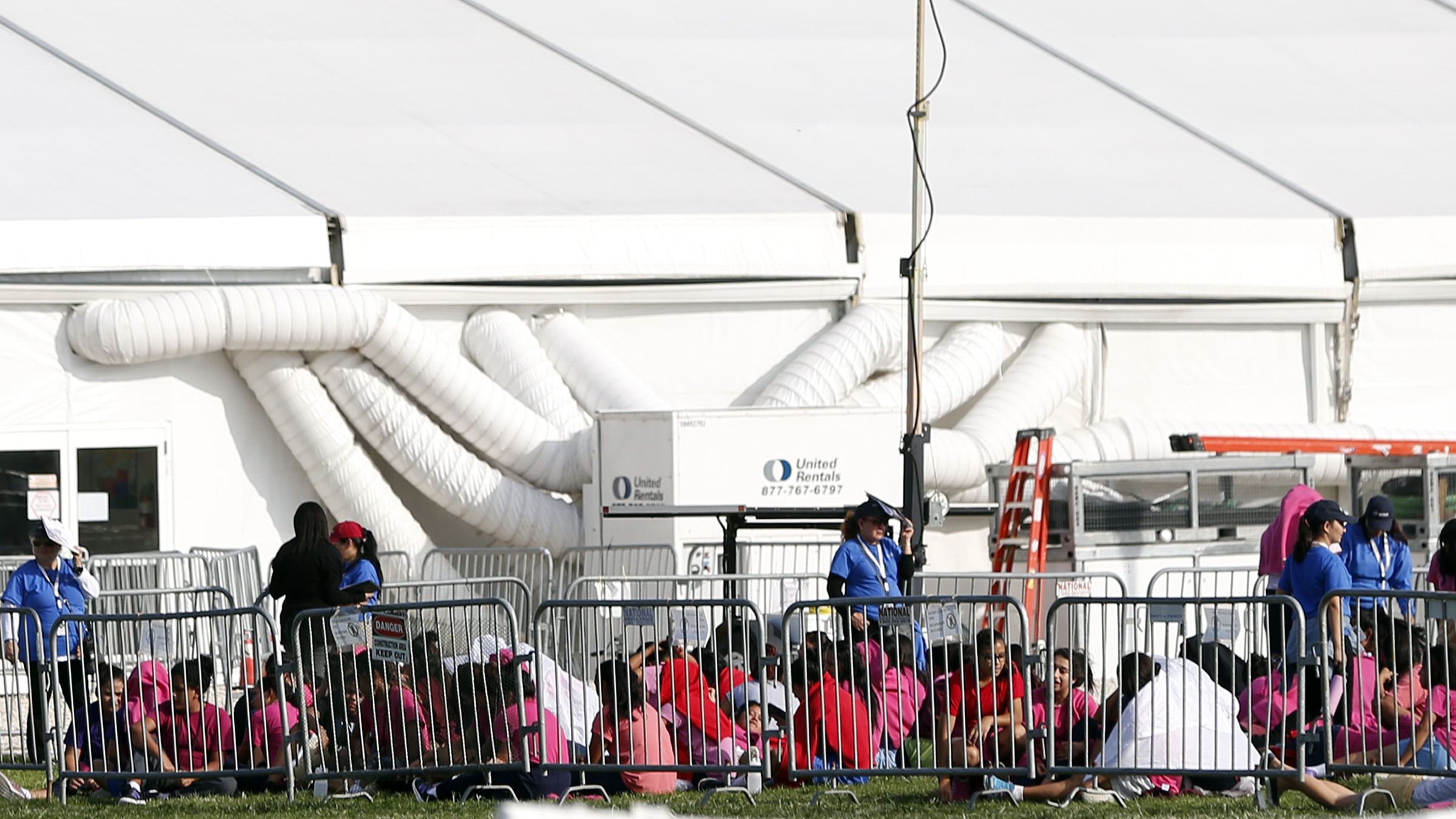 Immigrant children are shown outside a former Job Corps site that now houses them, Monday, June 18, 2018, in Homestead, Fla. It is not known if the children crossed the border as unaccompanied minors or were separated from family members. An unapol...</blockquote>