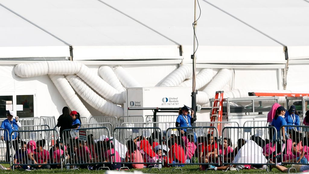 Immigrant children are shown outside a former Job Corps site that now houses them, Monday, June 18, 2018, in Homestead, Fla. It is not known if the children crossed the border as unaccompanied minors or were separated from family members. An unapol...</blockquote>      <footer class=